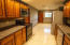 The kitchen offers plenty of cabinets to store all the necessities, and includes a pantry as well.