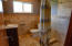 The guest bathroom is nicely located between the kitchen and bonus room.