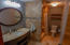Just off the bedroom hallway is the main bathroom with a built in shower seat for your convenience.