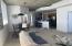 visible: living, dining, den, main bedroom door and kitchen