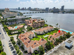 Gorgeous Townhome on Palm Beach Island with unapparelled views of the intracoastal, Flagler Bridge, West Palm Beach Skyline and some of most elegant yachts in the world.