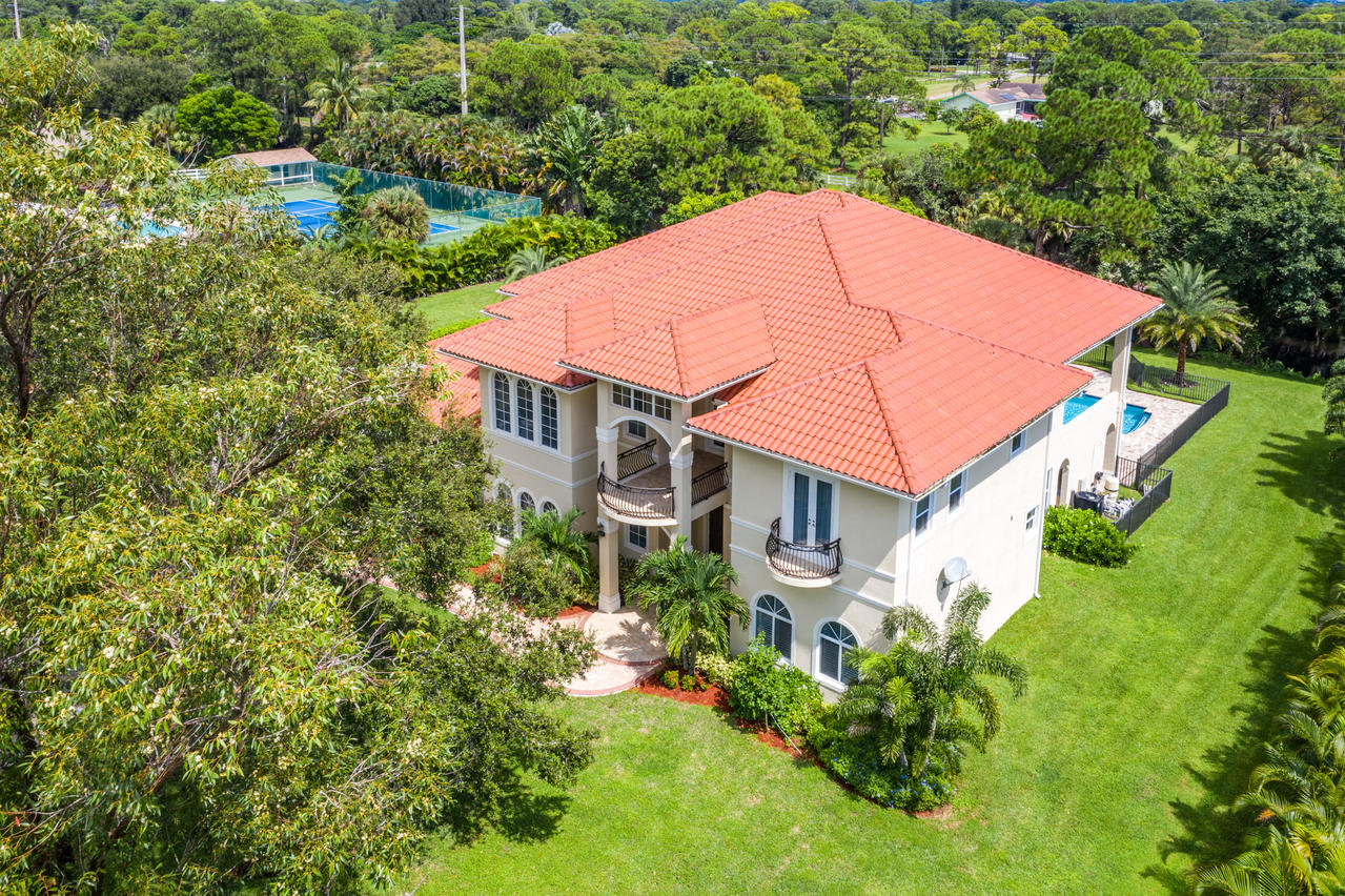 Stunning recently constructed contemporary 5 bedrooms, 5 bath, 1 half bath home w additional theater, office & private pool on 1.11 acres in Horseshoe Acres, a small & ideally located community in the heart of Palm Beach Gardens. Featuring: oversized marble and white tile downstairs w upstairs wood flooring, crown molding & ceiling detail, neutral contemporary tones w contrasting rich wood finishes & built-ins, security system & home automation, custom carpeting & plantation shutters, exceptional wet bar, stunning marble curvaceous staircase w delicate wrought Iron, formal living area w 2-story floor-to-ceiling windows & exceptionally mastered kitchen fitted w granite counters, upgraded wood cabinetry, double refrigerator, stainless steel top-of-the-line appliances & large walk-in pantry. Upstairs offers additional laundry room, loft & 3 guest suites complete w private bath & walk-in closets. Primary suite features coffee bar, sitting area, 2 walk-in California closets, private luxurious bath w walk-through shower, dual vanities & stand-alone tub. Home matched by serene outdoor area w full summer kitchen, covered lanai, upgraded spacious decking & salt-water pool surrounded in private tropical landscaping. Spacious 3 car garage offers convenient electric vehicle charging.