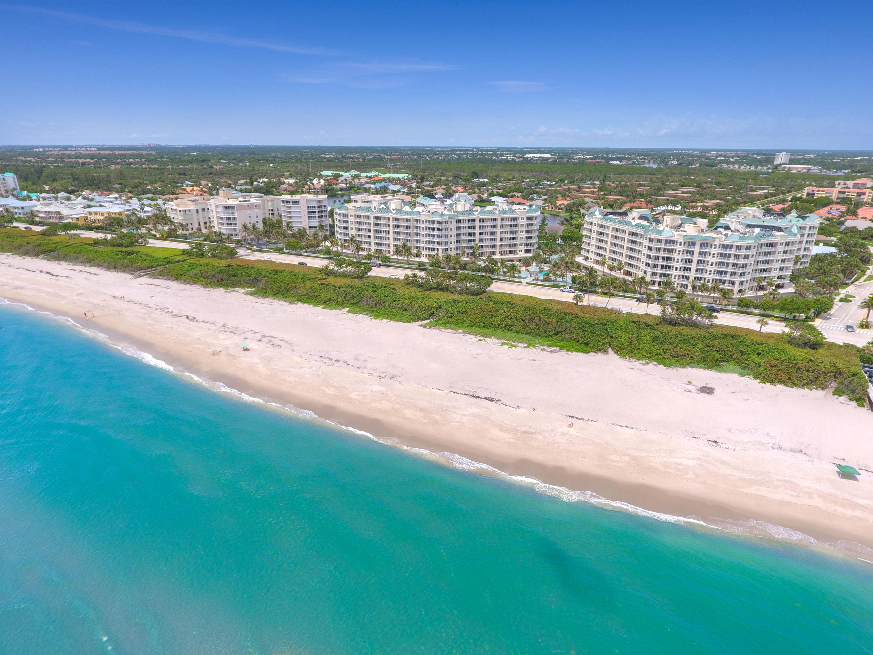 If you are looking for a gorgeous, West Indies decorated, oceanfront condo, you will find it here. This highly sought after floor plan is rarely available, offering spectacular ocean views. Enjoy 3 bedrooms, 2.1 bathrooms or keep as a 2 bedroom with den/office. This condo is sold furnished with high-end luxurious decor. Upgrades in this condo are endless. Recessed rope lighting, custom door handles, plantation shutters throughout, pristine trim carpentry work, designer ceilings, with wood and marble floors throughout. Even the laundry room is breathtaking. The master suite features sliding glass doors which lead out to the large terrace directly overlooking the ocean. Master bath offers separate shower, free standing tub and double sinks. Amenities include a 24-hour manned gated entrance, resort style pool and spa, fitness center, club room, billiard room, tennis courts, card room, 2 covered garage spaces and 2 storage rooms located on the same floor near the elevator. Large dogs welcome. Close to fine dining and shopping. Pet friendly beach.