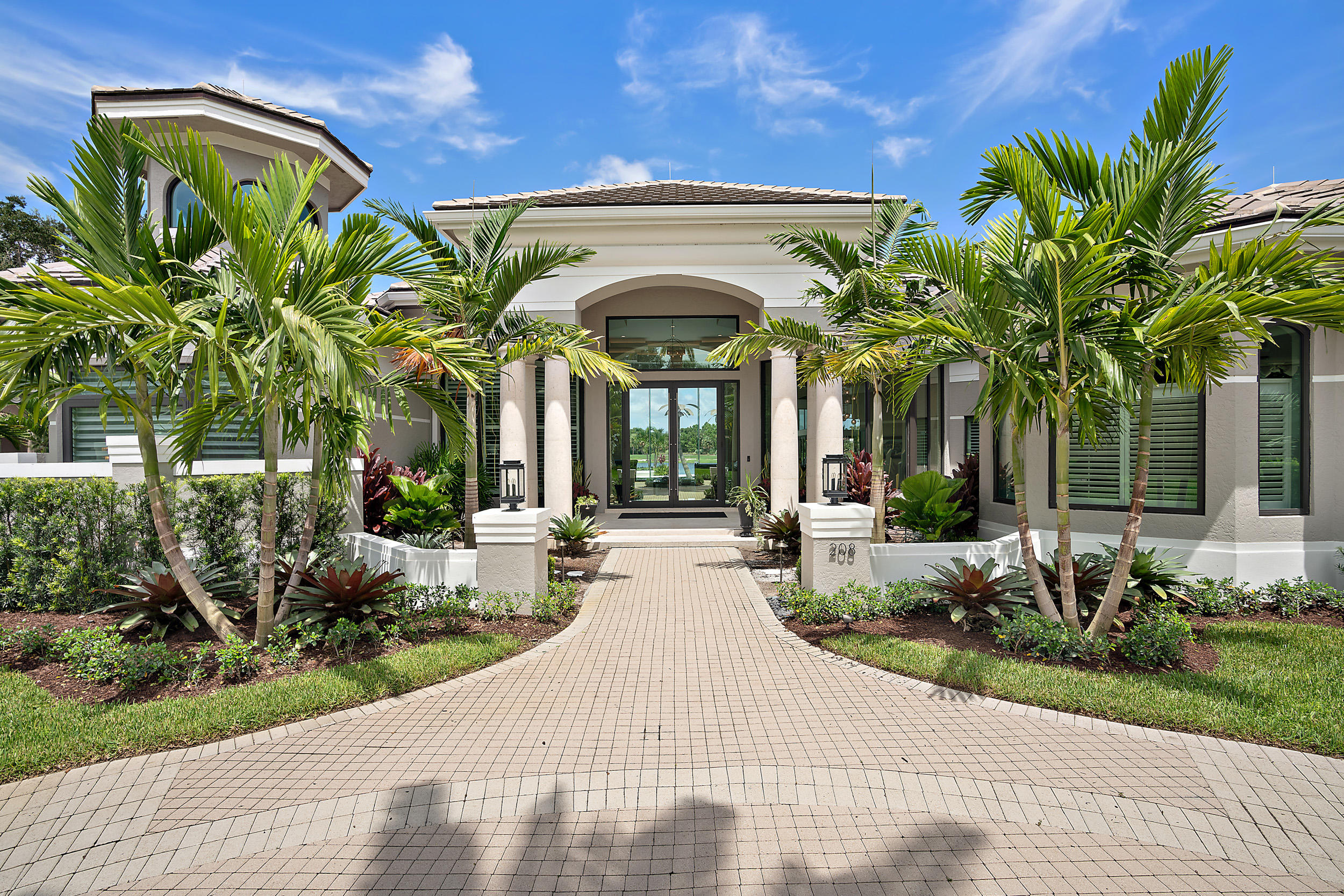 Spectacular estate in Loxahatchee Club completely renovated 2018 on rare over acre lot 1 of 4 double lots in this community. An entertainer's dream home with lake & golf course views seen the moment you reach the front door.Open floor plan boasts 20' coffered ceilings upon entry and spectacular, glass & suspended wire custom wine room holds/ 380 bottles.Gourmet kitchen to please even an iron chef with 10'x5' island & 6' custom made range from France.Oversized Master suite has separate his/her bathrooms & closets. Her's with 12' ceilings & island also master laundry room. 3-car garage with outdoor carpet and built ins.State of the art theatre.Large lanai & outdoor kitchen.House opens up with two walls of folding stack back doors. Putting green & oasis pool. Multi options for a 4th BDRM