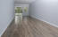 Newer laminate flooring in freshly painted LR/DR, view of enclosed porch overlooking garden