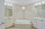 Expansive Marble Master Bathroom offers Double Vanities