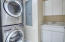 Laundry room features sink and Storage Cabinets