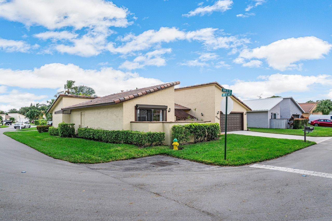 LOVELY ONE STORY HOME WITH UPDATED KITCHEN, BATHS & FLOORING, NEW ROOF 2020. COMPLETE HURRICANE PROTECTION PLUS PORTABLE GENERATOR. ENGINEERED WOOD FLOORING ALL BEDROOMS, TILE IN KITCHEN AND GREAT ROOM. VAULTED  CEDAR WOOD CEILING IN GREAT ROOM, SLIDING GLASS DOORS ACCESS THE LARGE SCREENED AND ROOFED PATIO. EACH ROOM OPENS TO A PATIO. MASTER HAS 2 CLOSETS, ONE WALK-IN, WASHER & DRYER ARE INSIDE,TWO CAR GARAGE IS ENORMOUS . KITCHEN HAS GRANITE COUNTERS AND STAINLESS STEEL APPLIANCES. LARGE, QUIET CORNER LOT AND HOA MAINTAINS IT COMPLETELY!  LOW MONTHLY FEE INCLUDES COMMUNITY POOL & TENNIS AS WELL AS THE LAWN. BEST LOCATION 8 MILES TO BEACHES AND MINUTES TO SHOPPING, DINING, MAJOR HIGHWAYS AND SCHOOLS. BEAUTIFUL HOME PRICED RIGHT. BUYER MUST