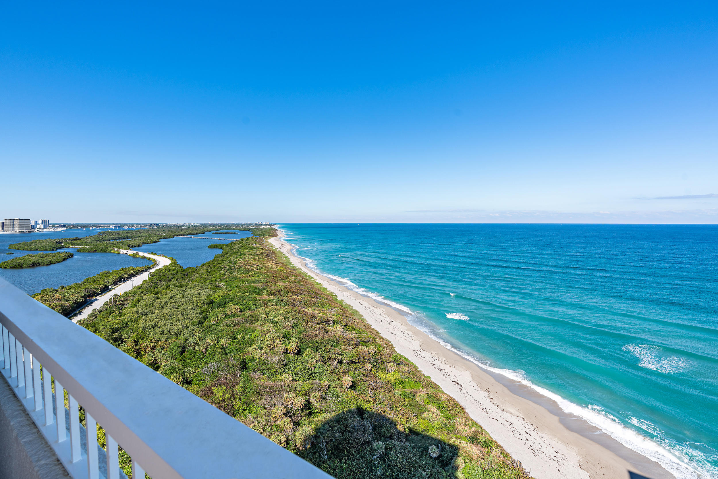 DIRECT OCEANFRONT CONDO with Unobstructed Panoramic Views Surrounded by Gorgeous Blue & Turquoise Waters Overlooking the Ocean to the East and John MacArthur Park just North with Incredible Water Views from Every Room! This direct east/southeast residence has floor to ceiling IMPACT GLASS windows and slider doors making it light and bright! Condo is ready to be designed with your own personal touch. Relax watching the boats cruise by while enjoying dining & drinks on your terrace with open views everywhere! This property possesses some of the best views on Singer Island! Property is easy to view, call today for your private showing! Water Glades residents have access to many amenities including private beach frontage, two heated pools, tennis courts, lush landscaped. See Supplement... recreation deck with an oceanfront owner's lounge with gorgeous views and plenty of space for entertaining. Each building has its own exercise room, library and extra storage. Water Glades is a 24-hour manned gated community just adjacent to MacArthur Beach State Park and nature preserve.  This building boats some of the best views on Singer Island!