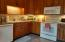 What a wonderful kitchen to make your own!! Make it cozy or bright--its a delight! So much cabinet space..wonderful work space