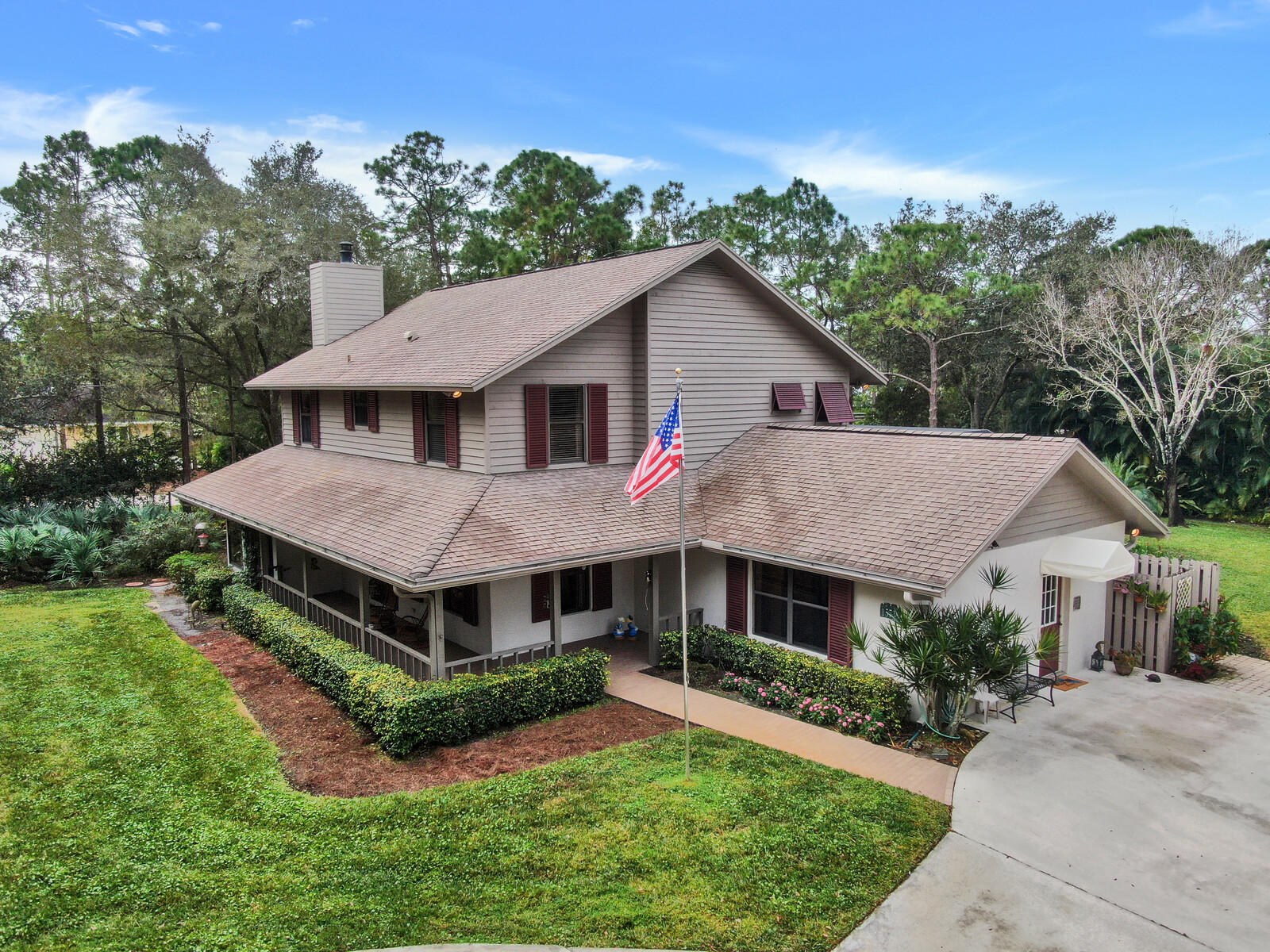 This porch-wrapped country home offers 4/bd/2.5/ba./3 car gar. with over 5500 total sq. ft. that exemplifies casual living inside & out. The kitchen-breakfast area has French doors that opens to a spacious covered back porch & gorgeous screened in pool area that includes a built-in grill. The family room has a warm down-home appeal with a wood burning brick fireplace and is adjacent to the dining room with access to the covered back porch & open patio area with beautiful landscaping & hot tub for easy indoor-outdoor entertaining. The second-floor features three bedrooms, a full bath & master suite that includes dual closets with one walk-in closet, a bath that has dual sinks a whirlpool tub, & separate shower. This home is further enhanced with an additional living/flex space on the main floor that could be used as a game room another bedroom or office with its own entrance & access to the cabana bathroom. The detached1320 sq.ft.3 garage has garage doors on the front and back for easy access and a covered motor home parking space. The property sits on 1.31 acres with gorgeous mature oak trees, fully fenced yard with gated entrance, abundant parking, corner lot and near a paved road.