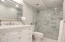 MARBLE SHOWER WITH FRAMELESS SHOWER DOORS