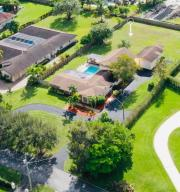 Aerial view of the almost 1 Acre fenced in lot surrounding multi-million dollar homes