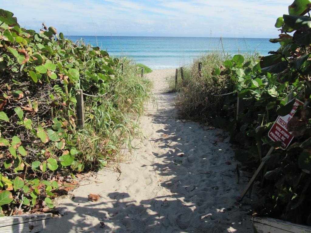 Split 2 bedroom, so exposure. Deeded beach access. New hurricane impact doors, pool, gym. Great location. Assessments paid.