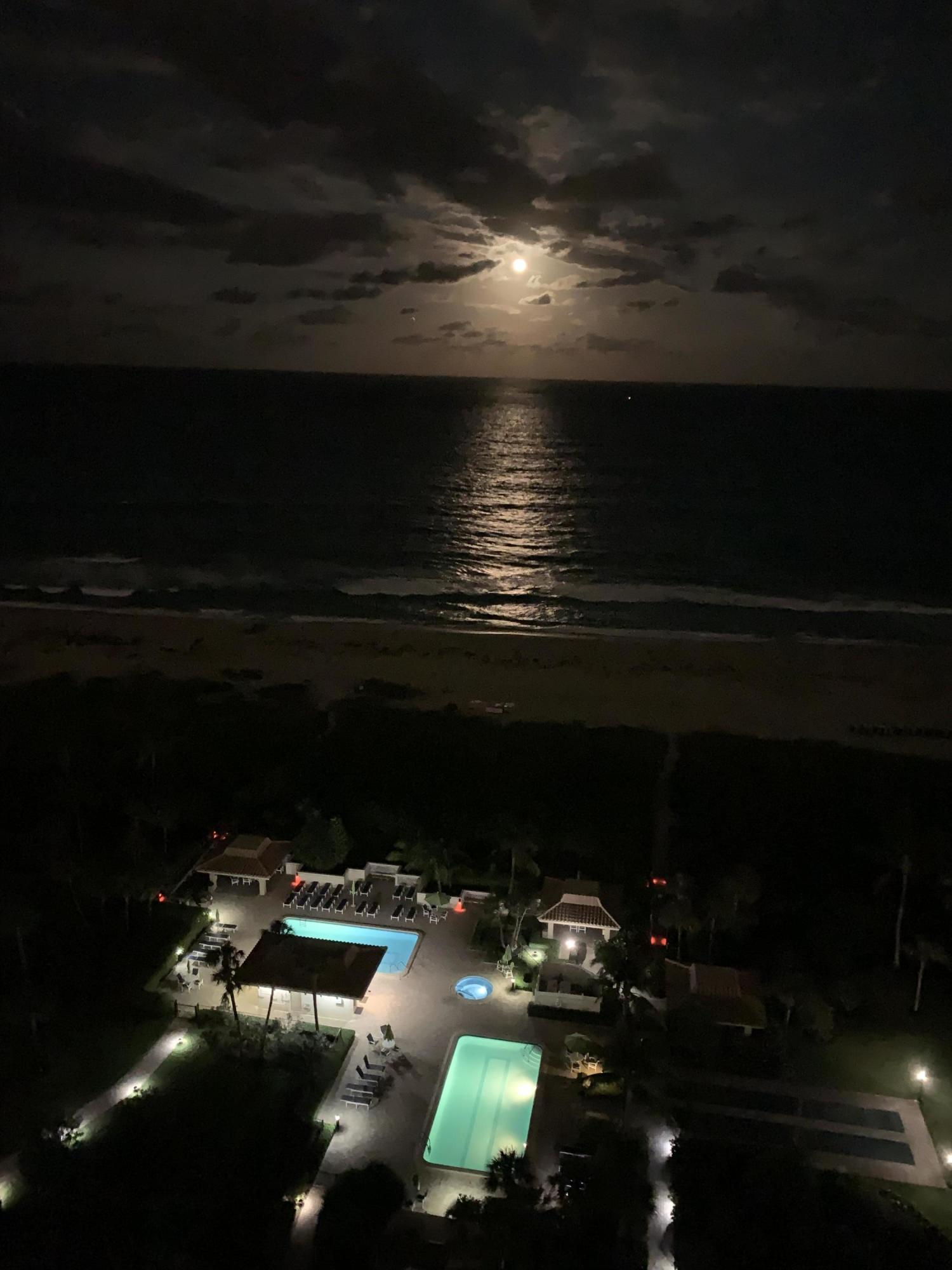 Night View of Ocean, pools, & grounds