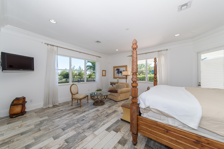 Large master bedroom with cabana door
