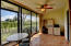 Florida Room can be fully enclosed under air, or opened up to a screen in patio