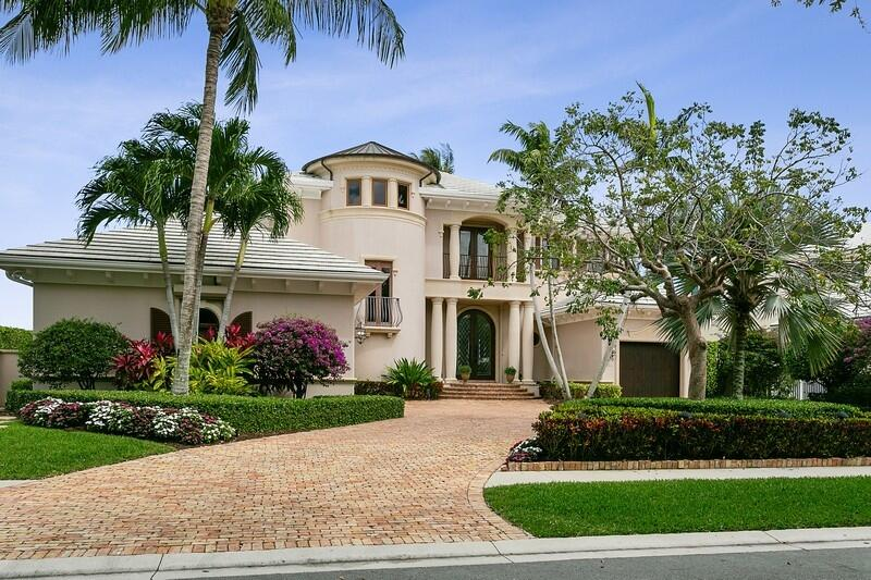 Exquisite custom built full two story Intracoastal Waterway estate home across water from nature preserve on nearly an acre of beautifully landscaped grounds in gated(manned) yacht club community. The ultimate house & property for entertaining. 4 bedrooms including upstairs master suite with his and her bathrooms, 2 built-in offices, 5 baths, 2 half baths, &  3 car garage. Gourmet chef's kitchen & pantry features newer appliances, a large island with sink, 2 dishwashers, 2 new ovens, a new 6 burner gas cooktop & a warming drawer. Formal DR & LR. Enjoy panoramic views of yachts cruising the Intracoastal from the kitchen, great room, living room, breakfast nook, & 2 upstairs MBR's Luxury finishes include marble floor and faux finished walls & ceilings throughout. Pecky cypress balconies. Upstairs each master suite and throughout downstairs patio. Putting green/dance floor, sand trap, ,heated pool & spa. 180 gallon saltwater living coral reef aquarium, summer kitchen, full house (65 kw) Kohler generator, and boatlift.  Existing dock with electric and plumbing and a seawall are currently being replaced and will be completed soon.