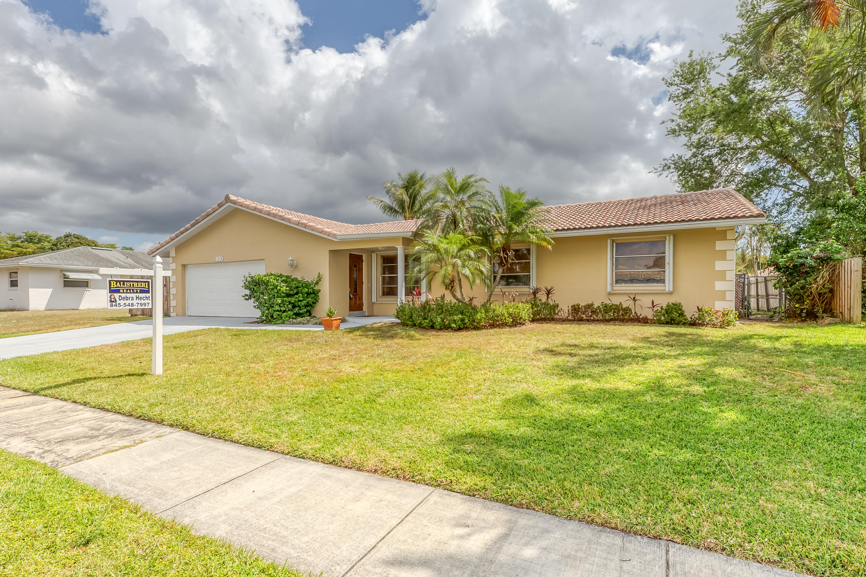 THIS CHARMING HOME IS NESTLED IN CENTRAL BOCA  ALONG THE SOUGHT AFTER ST. ANDREWS CORRIDOR. NO HOA AND MINUTES TO GREAT RATED SCHOOLS INCLUDING PINECREST AND ST. ANDREWS.TERRIFIC AREA FOR FAU AND LYNN UNIVERSITY STUDENTS AND FACULTY..THIS HOME FEATURES EAT-IN-KITCHEN LEADING TO A SPACIOUS SCREENED ENCLOSED PATIO. THERE IS A LARGE FENCED IN BACK YARD WITH POOL FOR PLAYING. THERE IS  AN INDOOR LAUNDRY CLOSET OFF OF THE KITCHEN FOR CONVENIENCE. THIS IS A PERFECT STARTER HOME OR EMPTY NESTERS. CLOSE TO I-95, TURNPIKE, SHOPPING AND BEACHES. A MUST SEE, WON'T LAST LONG AND RIGHT IN A GREAT LOCATION! NEW ELECTRICAL PANEL INSIDE AND OUTSIDE, THE STOVE, MICROWAVE AND REFRIGERATOR , DECEMBER 2020THE BIG T.V. IN LIVING ROOM ON WALL DOES NOT CONVEY WIT