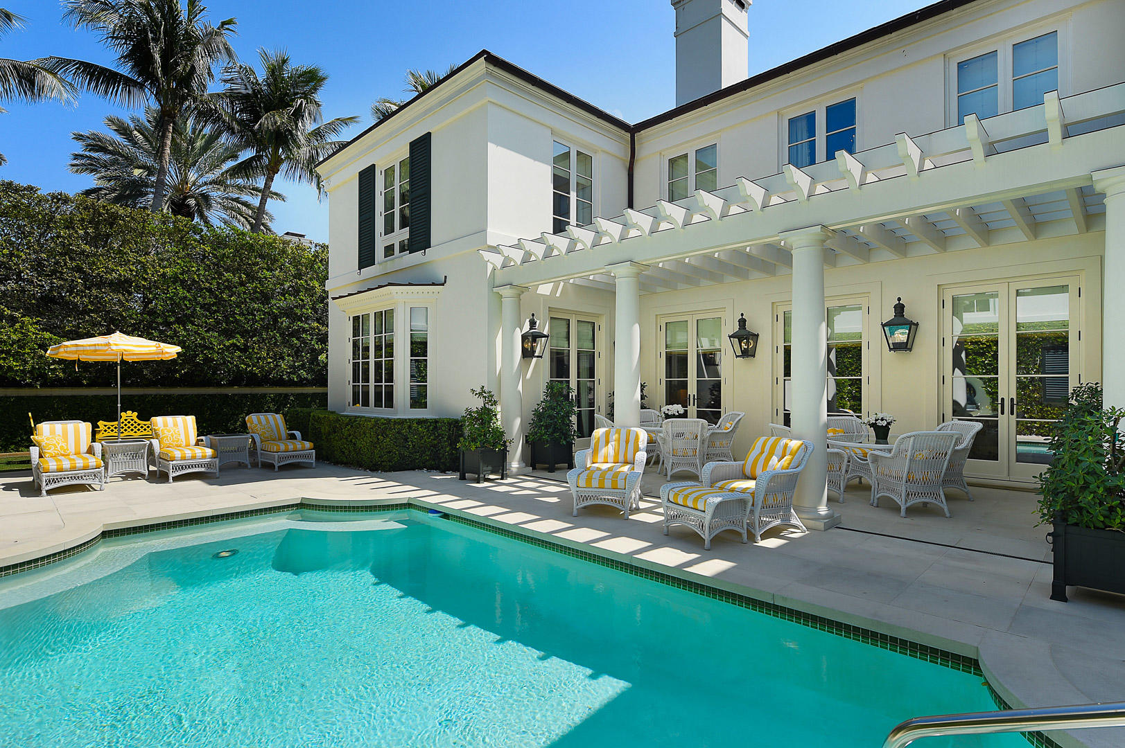 Spectacular 5BR/6.2BA home located in Palm Beach's acclaimed Estate Section, beautifully designed by award winning architect Mark P. Finlay. Features gorgeous antique limestone and antique hickory hand-scraped hardwood flooring, perfectly scaled rooms, and exceptional finishes throughout. Stunning paneled library with fireplace and full bath, first floor VIP guest suite, formal dining room, and first and second floor laundry rooms. Gourmet eat-in Chef's kitchen with Wolf and Subzero appliances leads to breakfast room and light-filled family room. Elegant formal living room with fireplace opens to pergola covered loggia and tranquil pool area. Additional highlights include soaring 10'+ ceilings on the first floor and 9' ceilings on the second, 1BR/1BA guest apartment, elevator, and full-house generator. Ample parking with circular drive and large driveway leading to 2 car garage.