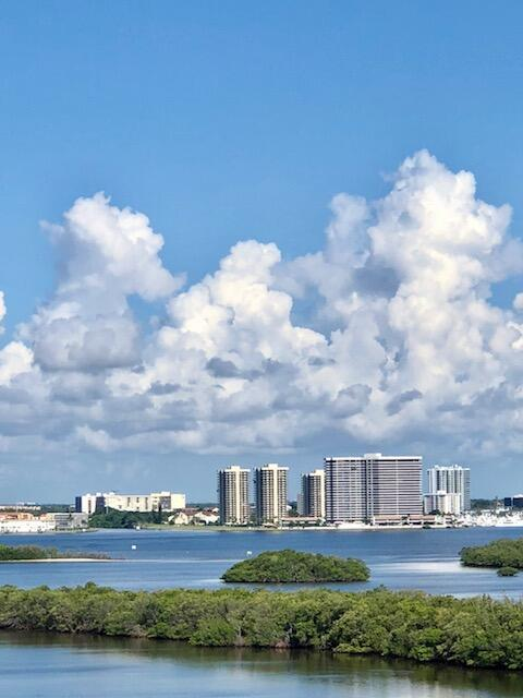 Fantastic intracoastal & ocean views from the NW corner, high floor (10) with large wraparound balcony for sun and shade, views of MacArthur Park to WPB.   Hurricane protection with shutters, strong UV windows and sliders, with partial impact glass.  Newer AC, hot water tank and electrical panel - all to current code.Split floor plan for privacy.  Renovate to current styles and taste.  Unoccupied and easy to show.  Maintenance contract included in fee.  Assigned parking space close to building. Furnished turn key, excluding personal items & artwork.