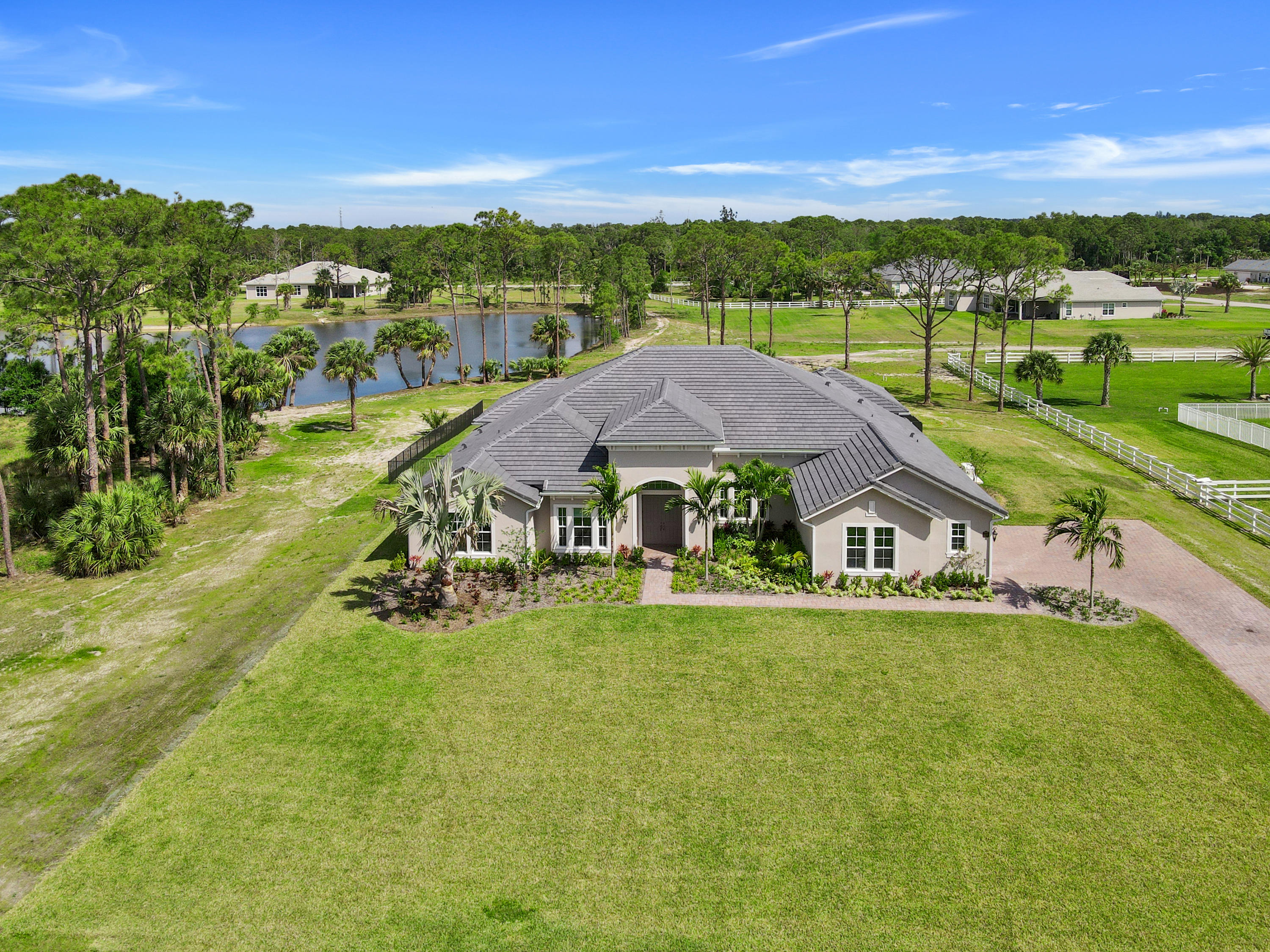 Stunning, new construction, 4 bedrooms, 3.5 baths, 3 car garage home on 1.52 acres in exclusive Reynolds Ranch. This home is on a very private waterfront lot abutting a preserves. Features include luxurious interiors, soaring 12' coffered ceilings, hard wood flooring, designer kitchen with solid wood cabinets, quartz counter tops, high end stainless appliances, double oven, gas stove and dryer. Additional features include a 1,000 gallon propane tank, 22KW Generac standby generator, instant heat water system and high performance impact glass and HERS certified. Relax and enjoy the large back yard overlooking the lake with the extended lanai, paver patio deck and aluminum pool fence. Reynolds Ranch is a gated community built on Burt Reynolds former 150-acre ranch... with two beautiful lakes, horse paddock, 4 miles of multi-use trails, day time riding. No horses overnight.
