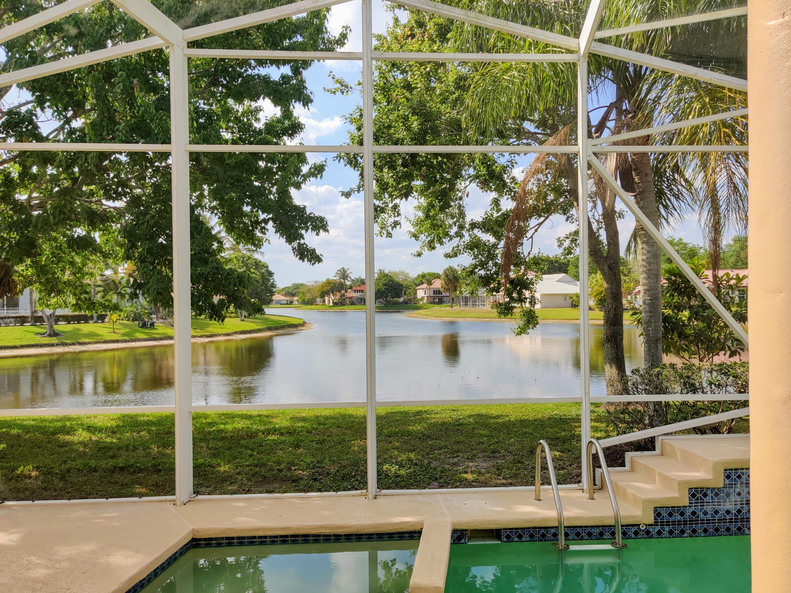 This Beautiful classic pool home overlooks a wide lake in The Shores of Jupiter. The home features high ceilings in the living, dinning, kitchen, and family room. Windows above the front entree door and sliding doors makes this home exceptionally light and bright. The home has three bedrooms plus a den for that extra office or guest room.