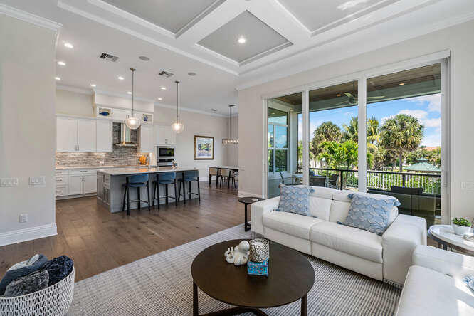 Welcome to this show-stopping property with lake views just steps away from the Atlantic Ocean at Juno Beach. This 2020 custom-built home is completely turn-key & meticulously designed with upscale finishes throughout. The spacious foyer opens to a gorgeous foyer with French doors to a private office & a stairway to 2nd floor bedrooms, bonus room & balcony w/magnificent sunrise views.  The luxurious dine-in kitchen w/ large island opens to a beautiful family room w/ coffered ceilings & wall-to-wall views of the outdoor oasis of Pelican Lake. First floor owner's suite offers a lavish bathroom, 2 gracious walk-in closets & a sitting area open to the screened-in saltwater pool & spa. The outdoor living area showcases the screened-in lanai & the impeccable, well-lit landscaping. Don't miss it!