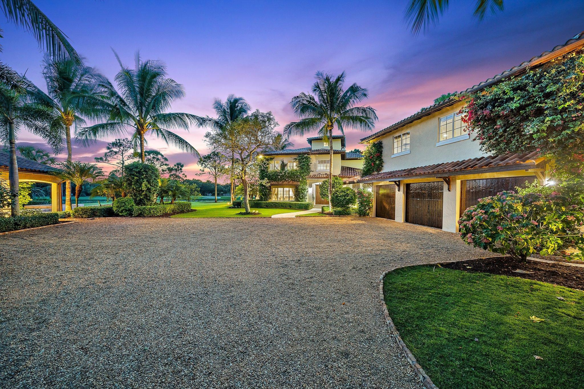 Spectacular estate situated on approx. 1.2 acres in the prestigious Trump National Golf Club, Jupiter. Overlooking the 12th fairway, water & green, this home offers over 7,100 sq.ft. of living space including a beautifully custom built main house featuring superior craftsmanship, an expansive gourmet chef's kitchen, wine cellar, large living spaces, high ceilings, an elevator and so much more. A luxurious private guest suite is set atop the 3-car garage. The spa inspired pool house boasts a sauna, steam room, gym, a full kitchen, cigar lounge & a wood fire pizza oven sets the mood for sunset dining. The meticulously maintained landscaping ensures complete privacy with beautiful lush gardens and putting green. An extensive indoor/outdoor living space makes this home an entertainer's dream.