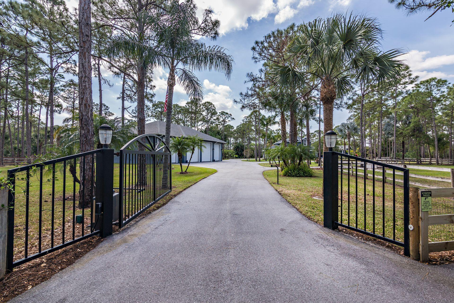 "All sizes approximateYour dreams have come true! This is the house you will proudly call home!This home has the space and privacy you have been looking for! Want out of the city but remain nearby...here it is!! This picture perfect home sits on 5.27 beautifully manicured acres! Property is all framed in with a three board fence and a impressive automatic gate!Home has been completely updated and is truly turn key!Once through the gate you will be escorted along a new expanded asphalt driveway meandering along the parklike setting. Recently freshly landscaped including plants, trees and even sod!As you walk up to the home the recently expanded and remodeled front porch will welcome you in. Home has recently been painted and redesigned with a modern day farm house feel A new roof was added in 2020 along with an leaf filter gutter system that runs under ground. Almost 100K spent on the remodeled kitchen! This magnificent kitchen will be your happy place with quartz countertops and an abundance of custom soft close cabinetry! Farmhouse sink, large pantry, custom lighting and a chefs French door oven. Stainless steel appliances and oversized Dutch door refrigerator.  Sunny breakfast room is large enough for a full size dining room table. Plantation shutters through out add to the comfortable but elegant feel.  Large formal dining room with built in wine cellar, crown molding, coffered ceiling and a large picture window! The gathering room will be a favorite spot to relax! Centered around a beautiful ceiling to floor stone faced fireplace. A wall of impact glass that gives you the feel of being outside! The Gathering room has access to the pool and patio. There is an office that is perfectly placed off the gathering room. All bathrooms completely updated in 2017 and 2018.   There are two master suites on the first level, they are conveniently separate at opposite ends of the home. Both have been completely updated and offer beautiful slider/french doors to the outside. The main master offers his and her vanities, seamless shower and a elegant stand alone soaking tub. Custom lighting and a private water closet! Both master suites have an abundance of closets with closet organizers. Main level offers a second family/game room/media room. Measuring 22X25 this room can be anything you want it to be. Would be perfect for the home office with its own private entrance and access to the two car attached garage. Laundry room is also located on the main level with a utility sink and cabinets galore!  The new staircase will take you upstairs to the perfect hangout. The common area that all three upstairs bedrooms share is that perfect place for homework, tv or computer. The upstairs bedrooms offer one as an en suite with private updated gorgeous bathroom and walk-in closet. The second and third bedrooms share an updated bathroom. All bedrooms are ample in size with large closets.  Stepping onto the lanai is like stepping into your private retreat. The invisible screen is automatic and will disappear or reappear with a touch of a button! The oversize patio deck offers plenty of space to relax by the pool! Pool has been renovated to include new stone, tile, autofill and an expanded wrap-around pool deck. There is also a convenient outdoor shower.  Current owners have added extra electrical outlets on the lanai for a future summer kitchen and power awnings.   Your four legged babies will love this center aisle barn that has been recently updated! Four stalls, a tack room/office that has A/C, new floor, cabinets and new lighting. New weather-grade ceiling fans and lights, automatic waters, wash rack and run out stalls. Fly system has new pumps and spay heads. Three large paddocks. Barn has an oversized utility shed for extra storage. New gutters were recently added as well as a fresh exterior paint and tack room remodel.  Calling all those with lots of big toys! This is the real deal! CBS built and one of a kind! 5 overhead doors, 1 door is 14 foot high allowing the ease of parking a motorhome or large boat! Four other overhead doors are 12 feet high and have commercial grade auto openers. At almost 2400 sq. ft. of air conditioned space you may never want to leave. This spectacular garage offers a full bath and a kitchenette.  Two part epoxy floor that will be there forever! Two welder receptacles, electric receptacles every 8 feet and three retractable electrical cords. Air lines strategically placed for a central compressor. Center part of garage slab was purposely poured thicker ( 6"" 3500 PSI) for future lifts. Garage is serviced by automatic generator, as is the whole property! Never without electric at this home! This garage is perfect for the car enthusiast!  One of the many amazing features of this property is the 45 KW whole property automatic generator. Property has a 1,000 gallon underground propane tank for the generator!  Auto on within 15 seconds of power going off. 2 transfer switches feed a pair of 200 amp panels. This generator powers the house, barn, and detached garage, everything!  Just a few of the upgrades and amenities include,  Home has recently been painted inside and out All windows and all doors on entire property are hurricane impact. Interior remodel in 2017 All light fixtures inside house replaced in 2017 Complete new landscape package in 2020-2021 Pool deck/patio expanded and upgraded in 2020 Two irrigation systems that were updated in 2018-2020 and are regularly maintained. Pool renovated in 2020 Garage/Shop built in 2019 Complete exterior remodel in 2020, including stucco that looks like lap siding, new roof, new windows, shutters, new screened lanai and gutters.  Entire driveway lengthened and surfaced with asphalt 2019 New Kitchen 2017 All bathrooms new 2017 New flooring 2017 New stairway 2017 New Interior Doors 2017 New septic/drain fields 2017 New gutters on the house, garage and barn (leaf filter) intricate underground gutter drain system. Upgraded water system, new pump and new water well in 2020    45 KW whole property automatic generator 1000 gallon buried propane tank for generator. The list goes on and on!! Hurry don't wait this one wont last!  The wonderful community of Caloosa is an equestrian community that consists of 350 five acre home sites in Palm Beach Gardens. Fifteen minutes to Fla. Turnpike, 95 and the Gardens mall. Twenty five minutes to downtown West Palm Beach & Palm Beach International Airport. Caloosa's 32 acre horse park makes this neighborhood a real estate gem in Palm Beach County with over 30 miles of interior horse trails. Caloosa's community amenities include: dressage arena, a riding arena, jump course and a cross country area. Multiple tennis courts, children's playground, basketball courts and a barbecue area, community meeting room and restrooms. The private park is for the exclusive use of Caloosa residents and their guests. Caloosa residents enjoy events such as movie nights, chili cook offs, barbecues, holiday parades, benefit rides, demonstrations, and horse shows."