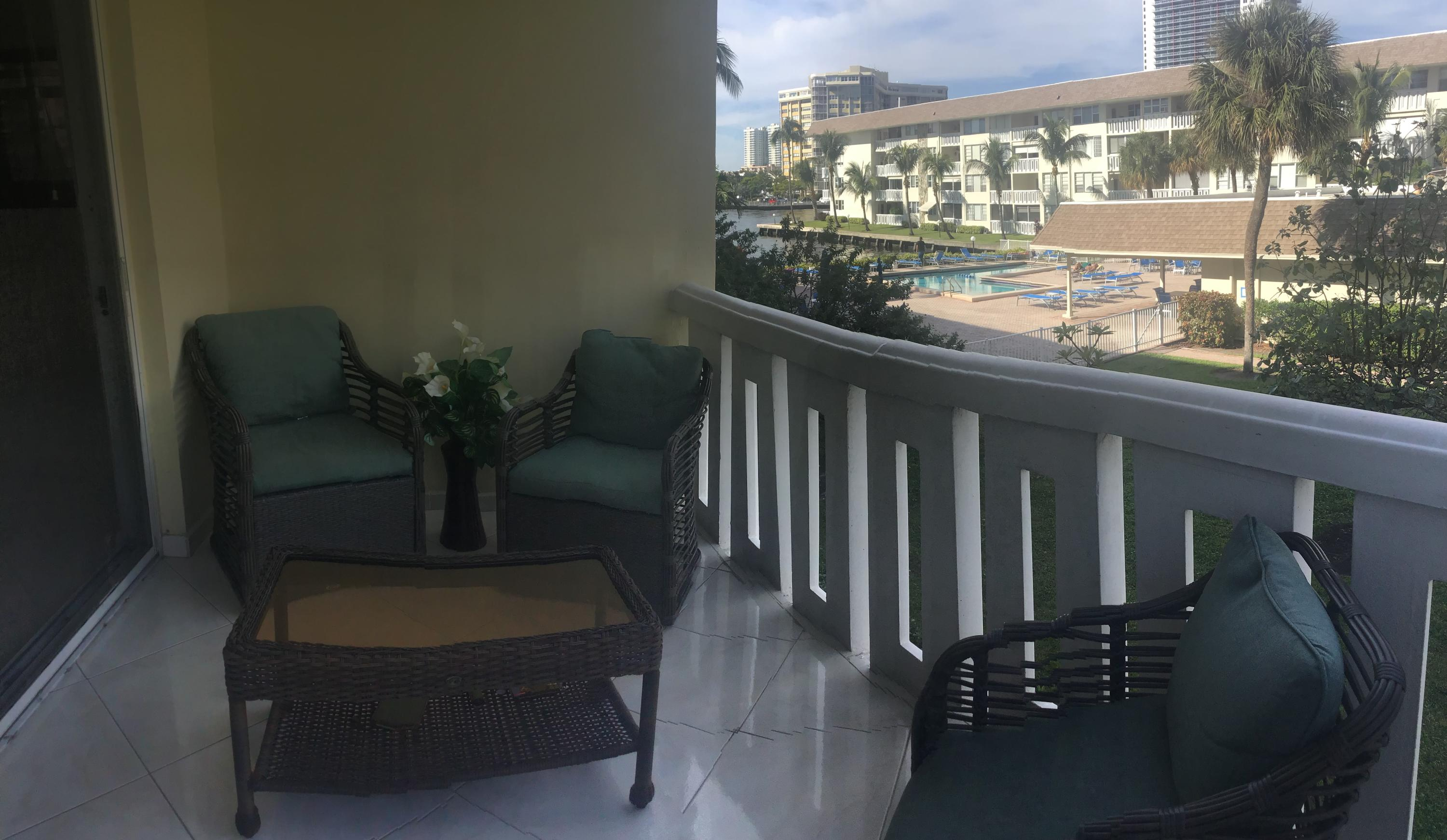 Open balcony with water and pool view