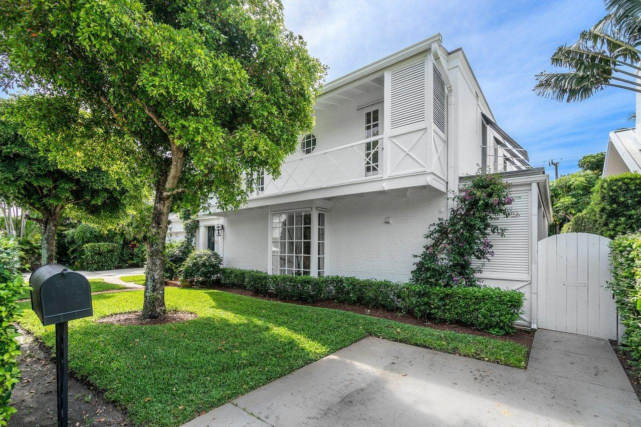 This charming historic 1935 English West Indies home was designed and preserved in the original classic Palm Beach style and features authentic architectural detail, hardwood floors, high ceilings and 2 fireplaces. This 5,252 square foot living space with pristine tropical decor includes a formal living room, dining room, large sunroom, eat-in kitchen, laundry room, 7-bedroom and 6 baths. Perfectly located 3 houses from the lake and bike trail, a short walking distance to a private beach access, the Breakers Hotel, Worth Avenue, shops and restaurants. The Four Arts Society with it's formal gardens, library and lecture theater is just a 5 minute walk away. The Everglades Club, The Bath and Tennis Club and other clubs are just a short 5 minute drive. The Palm Beach Day school is two blocks away.
