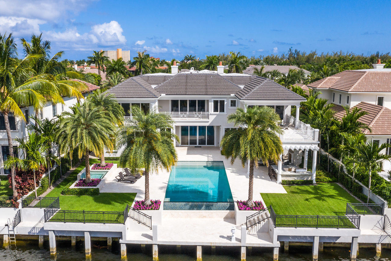 311 E Key Palm Rd, highly sought after newer custom waterfront transitional estate, build by SRD Corp. located on the widest part of  Fishtail Palm Canal on the cul-de-sac in RPYCC. Stunning estate with imported hard wood floors, beautiful view of the outdoor oasis with 20'x42' infinity pool and imported Italian marble boat dock. Estate features 6 bedrooms, 8.2 bathrooms, 12,502 Total Sq. Ft. 4.5 garage with golf card access. Large open floor plan with dream chef's gourmet kitchen, breakfast area, formal dining area, club room with bar, library/office, elevator, full temperature controlled wine room, Crestron system smart house, 2nd floor Master suite with his/hers bathrooms & fireplace, tons of storage throughout,  large loggia overlooking the outdoor oasis with full Summer Kitchen.
