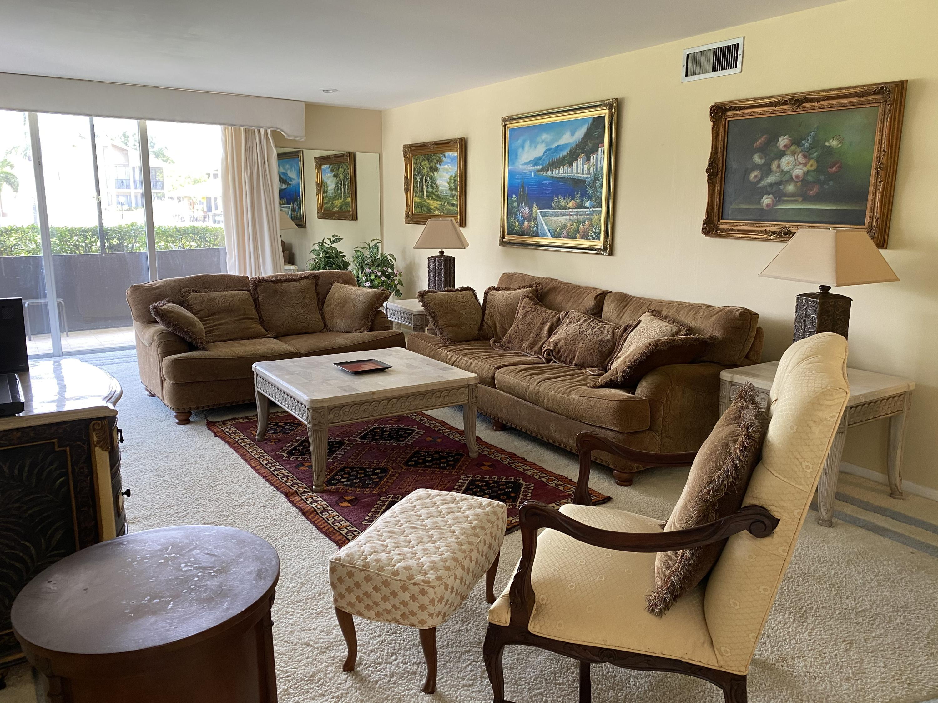 FIRST FLOOR END UNIT WITH SCREENED WRAP AROUND PATIO AND BEAUTIFUL VIEW. SPACIOUS, LIGHT AND COMFORTABLE WITH UPDATED, OPEN KITCHEN. KING BEDS IN BOTH BEDROOMS. WALK IN CLOSET IN MASTER. POOL AREA HAS SOCIAL GAZEBO AREA WITH BARBECUE. UPDATED CLUBHOUSE WITH EXERCISE AREA AND LIBRARY. LONGWOOD IS A 55+ COMMUNITY LOCATED OFF PGA BLVD. WITH THE BEST IN DINING AND SHOPPING. MINUTES TO GOLF COURSES, MARINAS AND BEACHES.