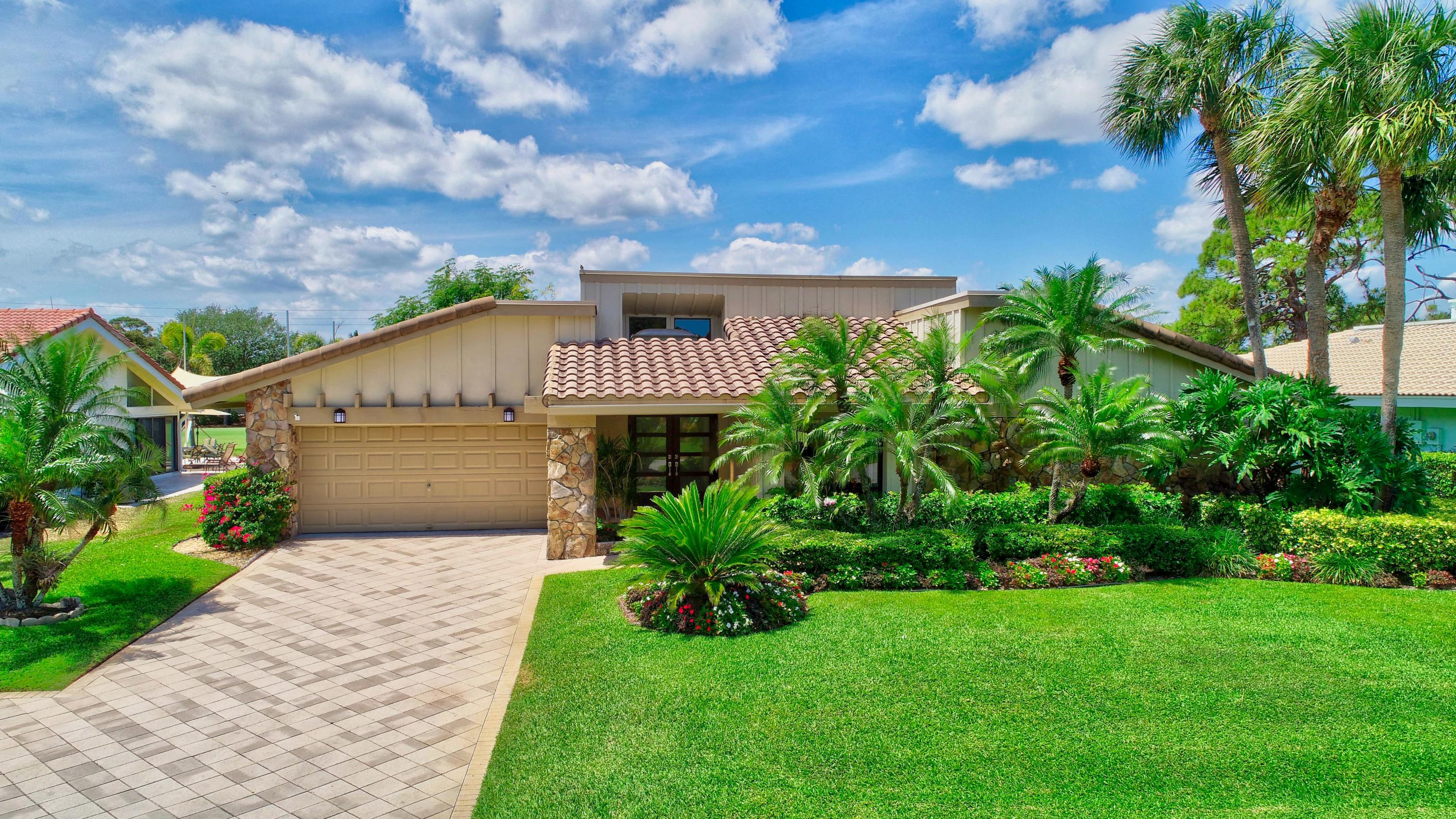 Meticulously maintained golf view home in highly sought Seagate Country Club at the Hamlet.  Open concept kitchen, dining and living space with soaring beamed ceilings, skylights and wet bar. Two master bedrooms, both ensuite, plus powder room. Convertible third bedroom is currently used as an office. Enjoy the golf view lot from screened porch and paver patio. Fenced back yard, with ample room to add pool & spa if desired. Roof replaced in 2013,  a/c 2016 & newer SS appliances.& HW heater. Front door, garage door & skylights are hurricane rated impact. Spacious FL room also under air cooled by split a/c (2020).  Rare find at this price point! Membership in Seagate CC is optional, not mandatory.  Best gated community location for access to downtown, beach, I-95, etc!