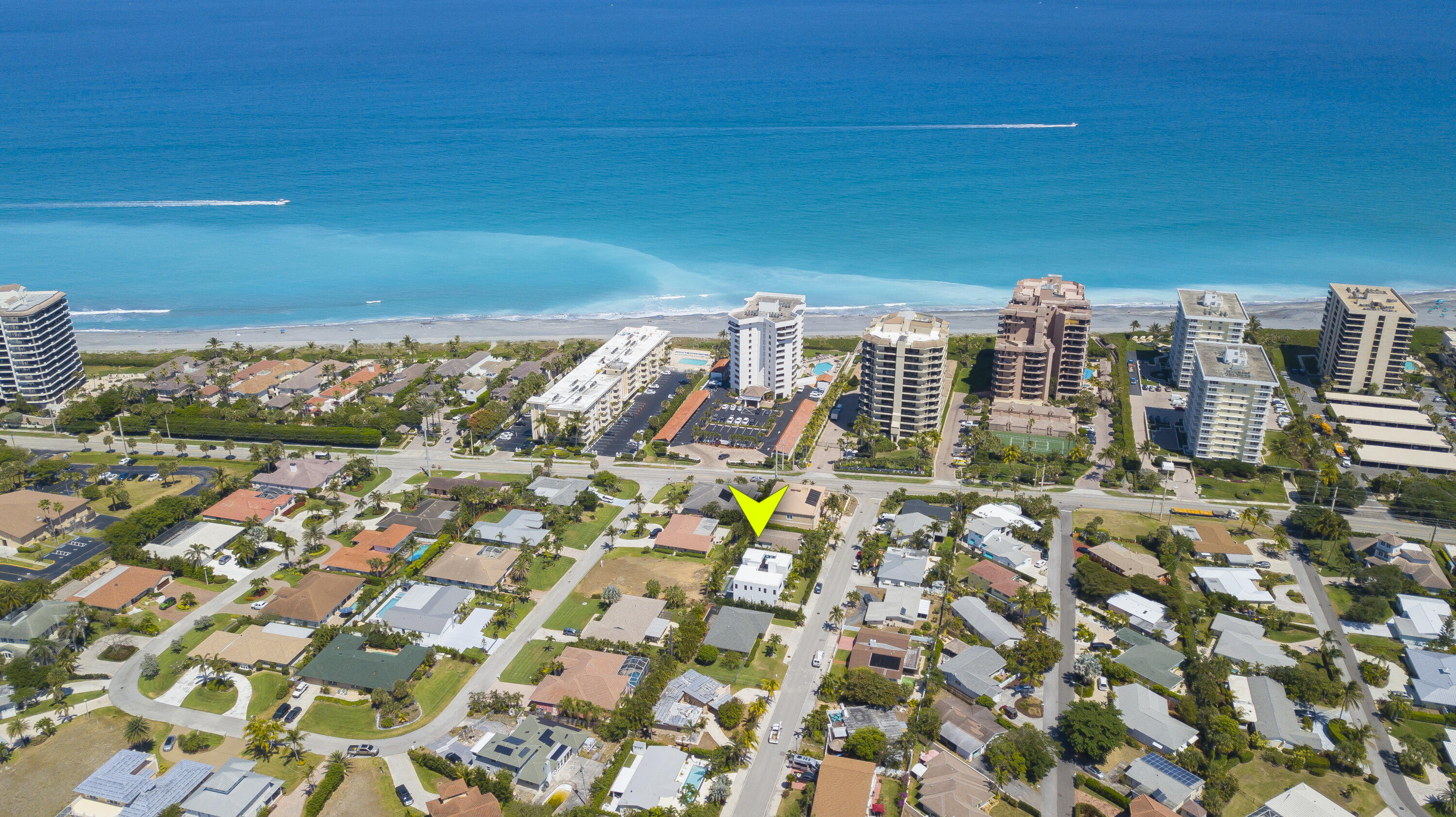 Rare opportunity to purchase modern 2018 built residence steps away from the sand of Juno Beach! Designed with style, innovation and functionality, this FULL-TURNKEY 3,613 AC sf residence with 4 bedrooms with on-suite bathrooms, powder bath, over-sized loft, & 2 car garage pool home, being sold with brand new designer, high end furnishings through out and all new custom window treatments. This residence features an open floor plan concept with high ceilings, an elevator that goes to the roof-top terrace. Enjoy nice ocean views from the master bedroom, balcony & rooftop. The gourmet island kitchen features modern designer white cabinetry with 6 cm azul calcite countertop on perimeter & extra white Caesar stone island with waterfall feature; SS Thermador 36 inch gas cooktop & triple combo built-in oven & Viking refrigerator. The master suite boasts of 2 over-sized walk-in closets with custom shelving, a luxurious bathroom setting, with his-&-her custom floating vanities, designer stand-alone tub & private balcony access with ocean views! This home features the latest state-of-the-art smart automation system, Kirio that can be controlled by your wireless device such as iPhone, tablet, etc. Built exceptionally well with all poured concrete & steel reinforced CBS tie-beam construction in the walls & between floors, using the Hambro system, the property is elevated about 27 ft above sea level, with hurricane impact resistant windows & doors throughout. The private backyard setting features a heated salt water pool with decorative wall & the perimeter hedges & tropical palm tree landscaping compliments the clean lines of the house. The entire home is a demonstration of the highest level of clean, contemporary finishes & the finest workmanship. This home was just professionally furnished and decorated with exceptionally taste and style, and is now move in ready. Other recent upgrades include extended ipe wood decking in roof top terrace; new custom fence and front gates to 