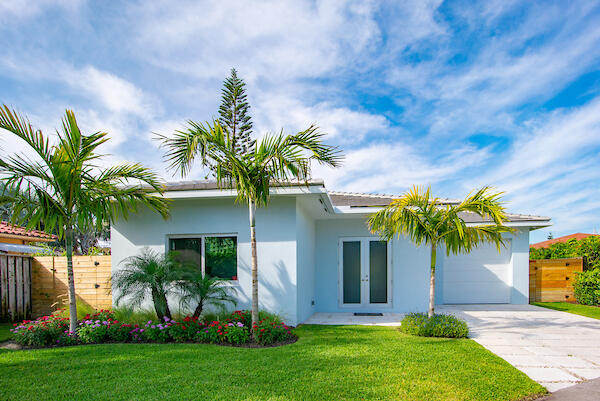 Fully renovated beach home in the highly sought after town of Juno Beach! High end finishes throughout this 2BR/3BA pool home with one car garage. Home was completely gutted and remodeled with impact glass, new roof, wood look porcelain tile, Kitchen Aid appliances and brand new swimming pool with Jandy salt chlorination pool pump. The A/C system was completely replaced with new ducts and vents and a 5 ton,16 seer Rheem A/C unit.  The bathrooms have seamless glass showers, custom mirrors and stylish vanities. Both bedrooms have walk-in closets with built-in cabinetry. The pool and back yard are very private with lush landscaping and new fencing. A new Rain Bird sprinkler system with drip hoses and sensors was added.  All of this and so much more to enjoy in beautiful Juno Beach!