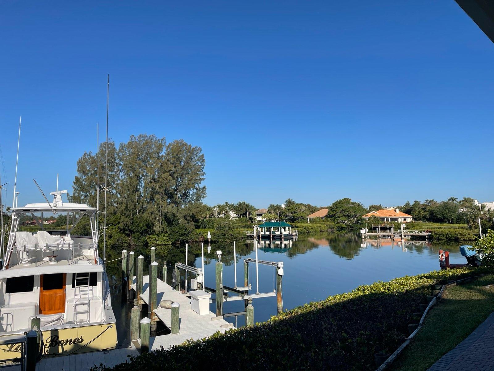 Magnificent waterfront property in Jonthans Landing with over 100 feet of water frontage.