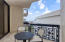 EXPANSIVE BALCONY WITH SLIDERS OFF MASTER BEDROOM AND DINING ROOM