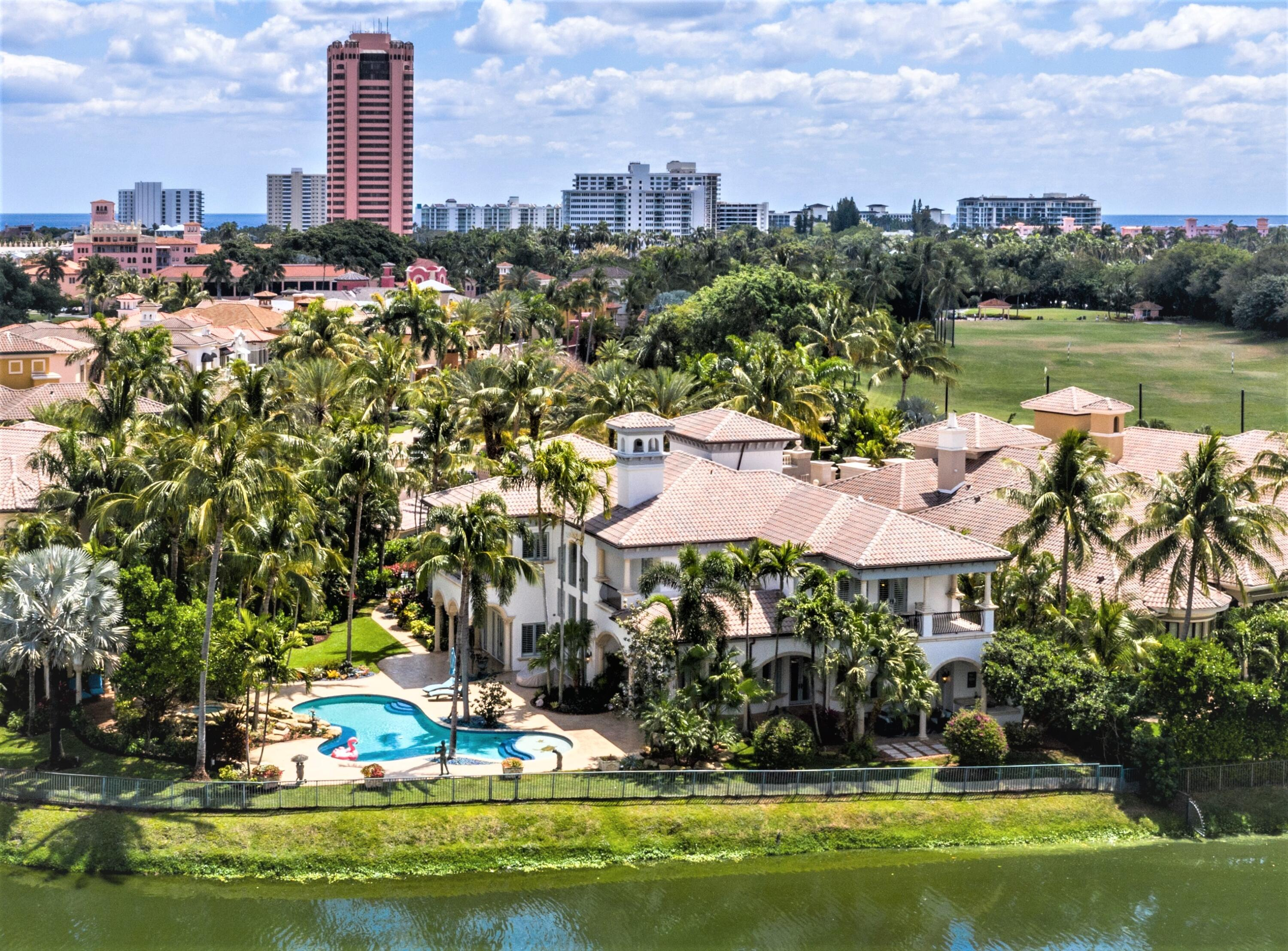 """Sited on OVER 1/2 Acre on the grounds of the Internationally renowned BOCA RATON RESORT & CLUB, a Waldorf Astoria Resort, in the Luxurious Private, Guard Gated Enclave of Mizner Lake Estates. 313 Mizner Lake Estates Drive is an extraordinary estate encompassing over 9,709 total sq/ft. Featuring 4 spacious en-suite bedrooms, 7 indulgent baths, an elevator, full house generator, impact windows, and a gated motor court w/ 3-car garage, this two-story residence offers opulent living with the sophisticated leisure and amenities of the Boca Resort at your fingertips.  With over 200' of lake and fairway frontage, you will enjoy gracious resort-style outdoor living spaces that cater to grand-scale entertainment with tropical grounds landscaped to perfection! The written and verbal information provided including but not limited to prices, measurements, square footages, and lot sizes have been obtained and conveyed from third party sources. The Sellers and Listing Company expressly disclaim any warranty or representation regarding all information. Prospective purchasers shall not rely on any written or verbal information provided when entering a contract for sale and purchase. In the event a Buyer defaults, no commission will be paid to either Broker on the Deposits retained by the Seller. """"No Commissions Paid until Title Passes."""""""