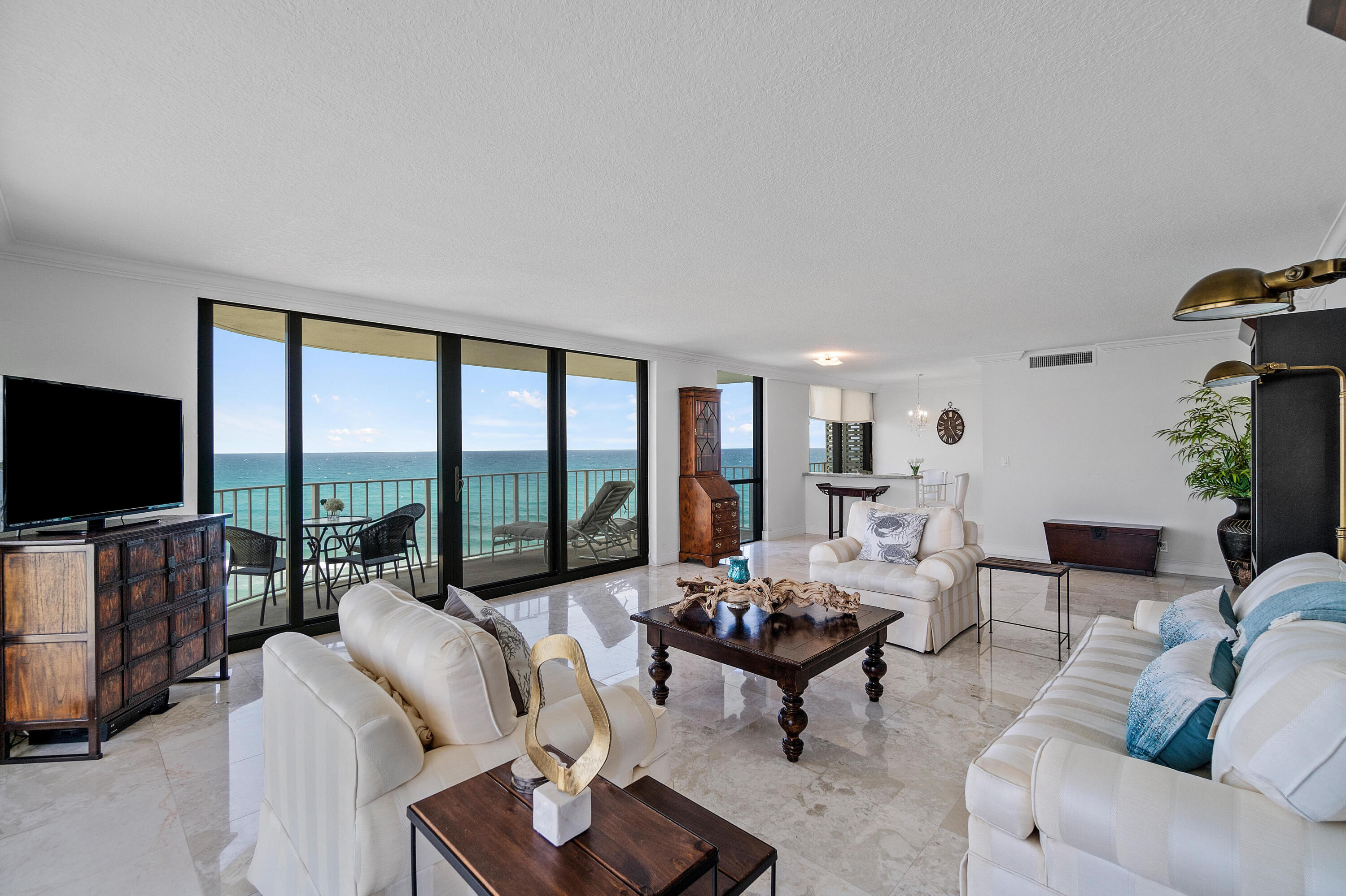 Amazing panoramic Ocean and Intracoastal views from every room in this expansive penthouse luxury Condo! Featuring floor to ceiling impact glass sliders and windows throughout the condo. Wrap-around balcony is deep and allows you to enjoy sunrise ocean and sunset intracoastal views, including access from each bedroom. Bedrooms are extremely spacious with hardwoods and ample fitted walk-in closets and additional storage. Updated kitchen and bathrooms, motorized sunshades, marble flooring and crown-molding are just a few key highlights of this home in the sky. Full-service amenity building offers 24-hour doorman/concierge, 2 new clay tennis courts, renovated gym, sauna, clubhouse, salt-water pool with entertaining deck & new grilling stations, premium garage parking, deeded private beach... access with a new lounge deck. Conveniently located near shopping restaurants, Palm Beach Lake Trail ideal for biking and walking, Par-3 Golf Course, Town tennis center and Palm Beach International Airport.