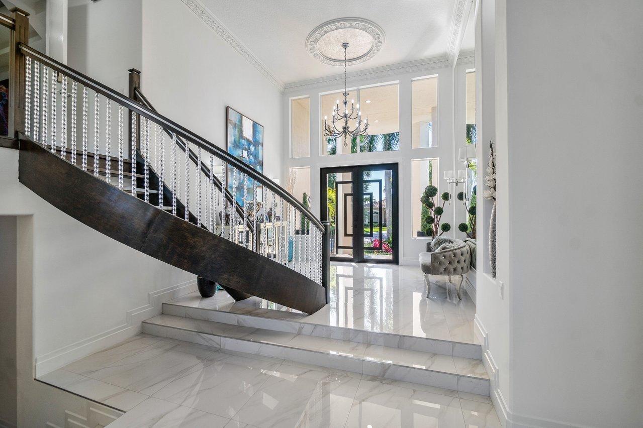 Foyer w/ Stair Case to Master BDR