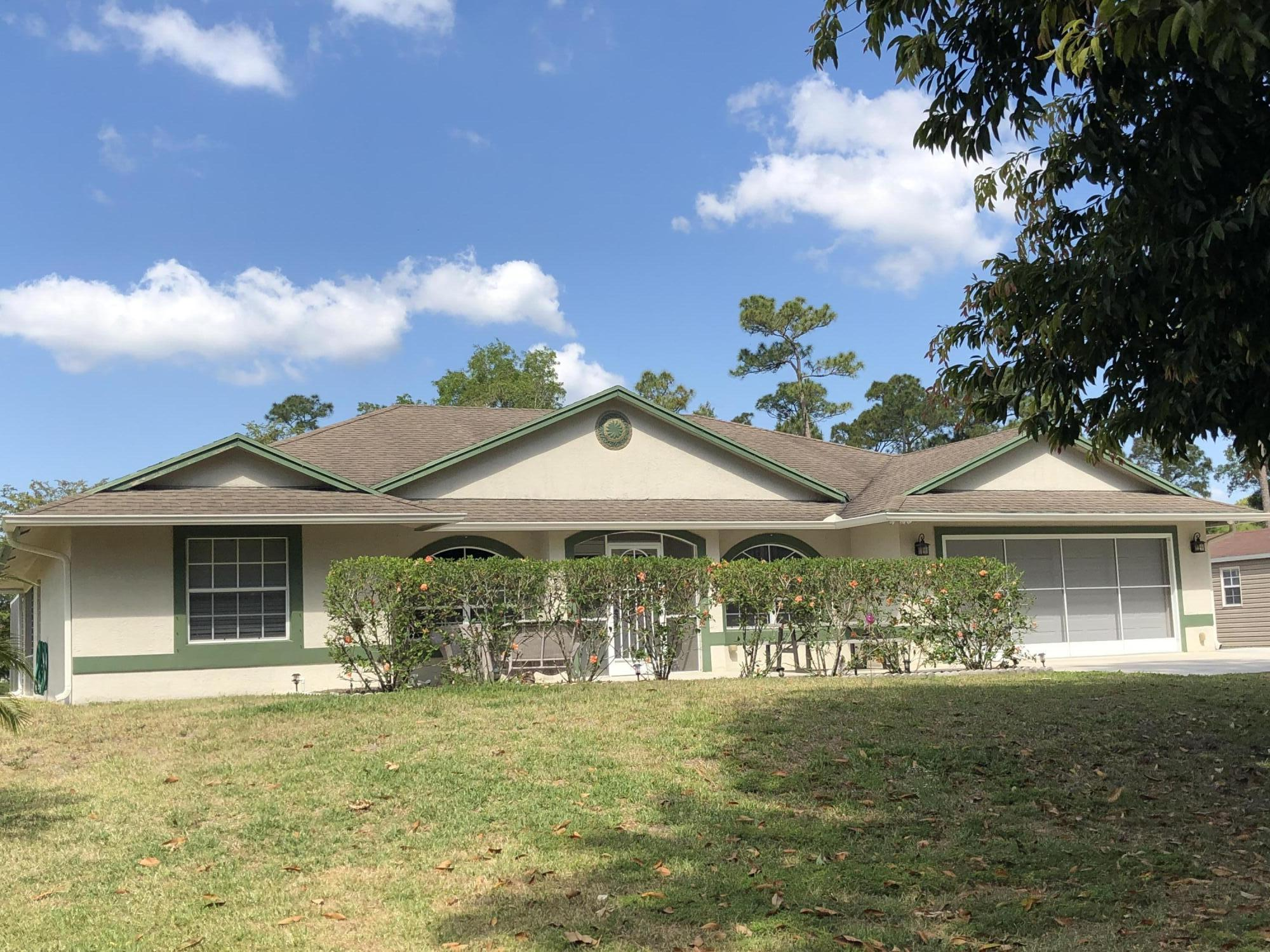 OPEN HOUSE  5/8/21,  3 BR + den, 2.5 BA, 2,900+ sq.ft, CBS Home w/ Solar heated, Chlorinated Salt water pool on 1+ acres in Jupiter Farms.  Home incl Gourmet Kitchen w/ granite counter, glass front cabinets & adjoining bay window-breakfast nook that overlooks pool.  Thoughtful upgrades incl: 11'x8' Butlers Pantry/Laundry room for extra storage & workspace, Crown molding w/ indirect lighting throughout living area; entry located den/office, 18' tile floors laid on diagonal throughout home, nested screen panels on garage door & screen door on garage side pedestrian door, making garage a cool, inviting workspace, 39'x15' patio overlooks pool; also adjacent to pool is 28'x11' orchid greenhouse w/ self-misting watering system.  Wonderful family home, on paved road w/ sidewalk in Jupiter Farms