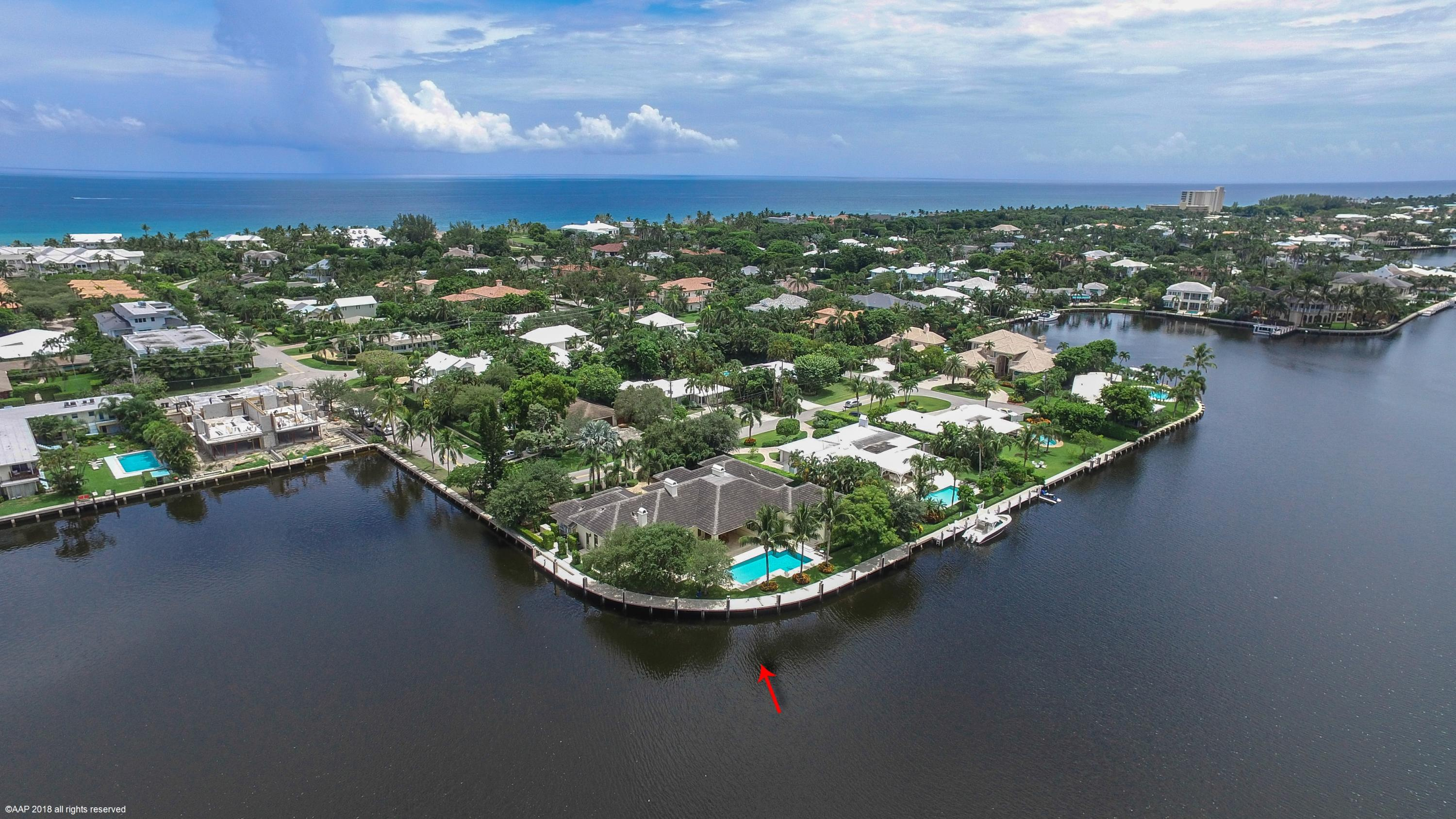 This Beautiful Custom Built One Story Gated Estate is situated on a .44 acre Intracoastal Point Lot with  253+/- of Waterfrontage in a desirable ''Slow Wake Zone.'' This is truly one of the Best lots in East Delray. The property is only Blocks to Atlantic Avenue and the Beach. Features Include an Open Concept Floorplan. Volume Ceilings, a Large Great Room with Fireplace, an eat in Kitchen boasting a huge center island, a beautiful brick designed Stove area and separate formal Dining Room, an Office/Den off the Master which includes a sitting area, a large Exercise Room & a glorious master bath. There's a separate ''wing'' w/3 en suite bedrooms which surround their own family Room The outdoor area is a dream w/a huge covered loggia, summer kitchen w/ pizza oven and Dockage for a large Yacht