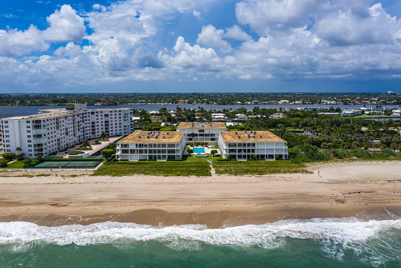 The Reef, designed by famed architect Gene Lawrence, was recently landmarked! Ideally located, this oceanfront 3-level boutique building is just south of Billionaires Row in Palm Beach. Beautifully renovated 2BR/2BA condominium with floor to ceiling sliders displaying ocean and Intracoastal views. Sunny, south-facing penthouse features a split floorplan with living space and both bedrooms open to an expansive covered balcony for private entertaining. Gourmet, open kitchen showcases stainless steel appliances and marble countertops. Pet friendly building includes pool, gym, garage parking, doorman and on-site manager. Adjacent to Phipps Park Tennis and nearby Raymond Floyd Par 3 golf and dining. Just minutes to famous Worth Ave, cultural centers and PBI Airport. See video from 2nd photo.