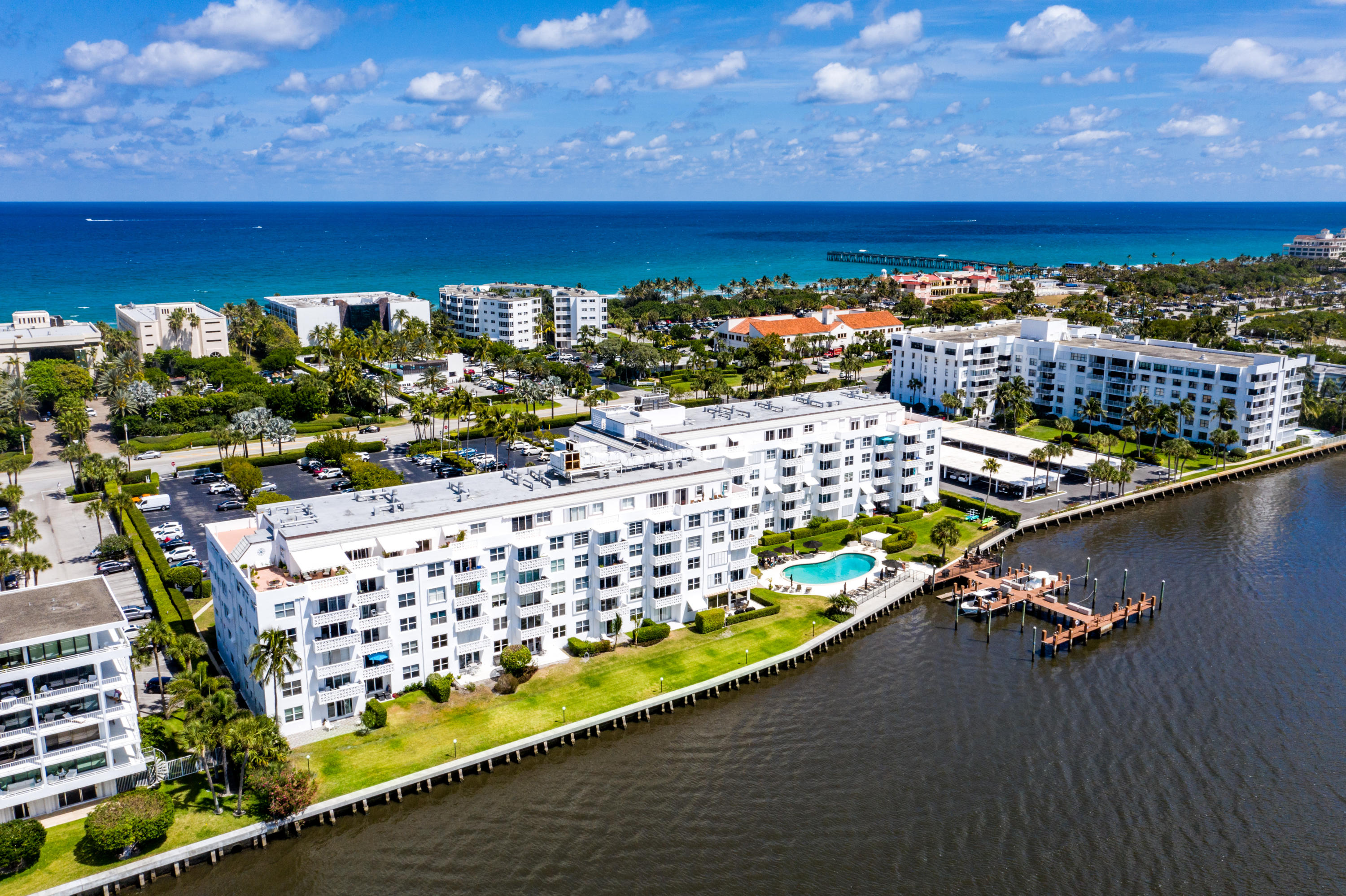 Beautiful Intracoastal waterfront corner unit in Palm Beach. Updated bath with impact resistant glass throughout.  Incredible value for Palm Beach Island!  Newer water heater and A/C.  Royal Saxon features a waterfront pool area directly on the Intracoastal Waterway with lounge chairs and a sundeck, 24/7 security, fitness room, social/club room, barbecue grills, and boat slips and kayak storage!  Just across the street from the beach, Four Seasons, restaurants and shops just steps from your front door!  All ages welcome, but no pets. See attached documents for coop rules and regs. All assessments for balconies and exterior building renovations have been paid for by the seller; move-in ready!  Maintenance fees include cable, water, exterior insurance, pest control, and amenities Glimpses of the Ocean from the Balcony.