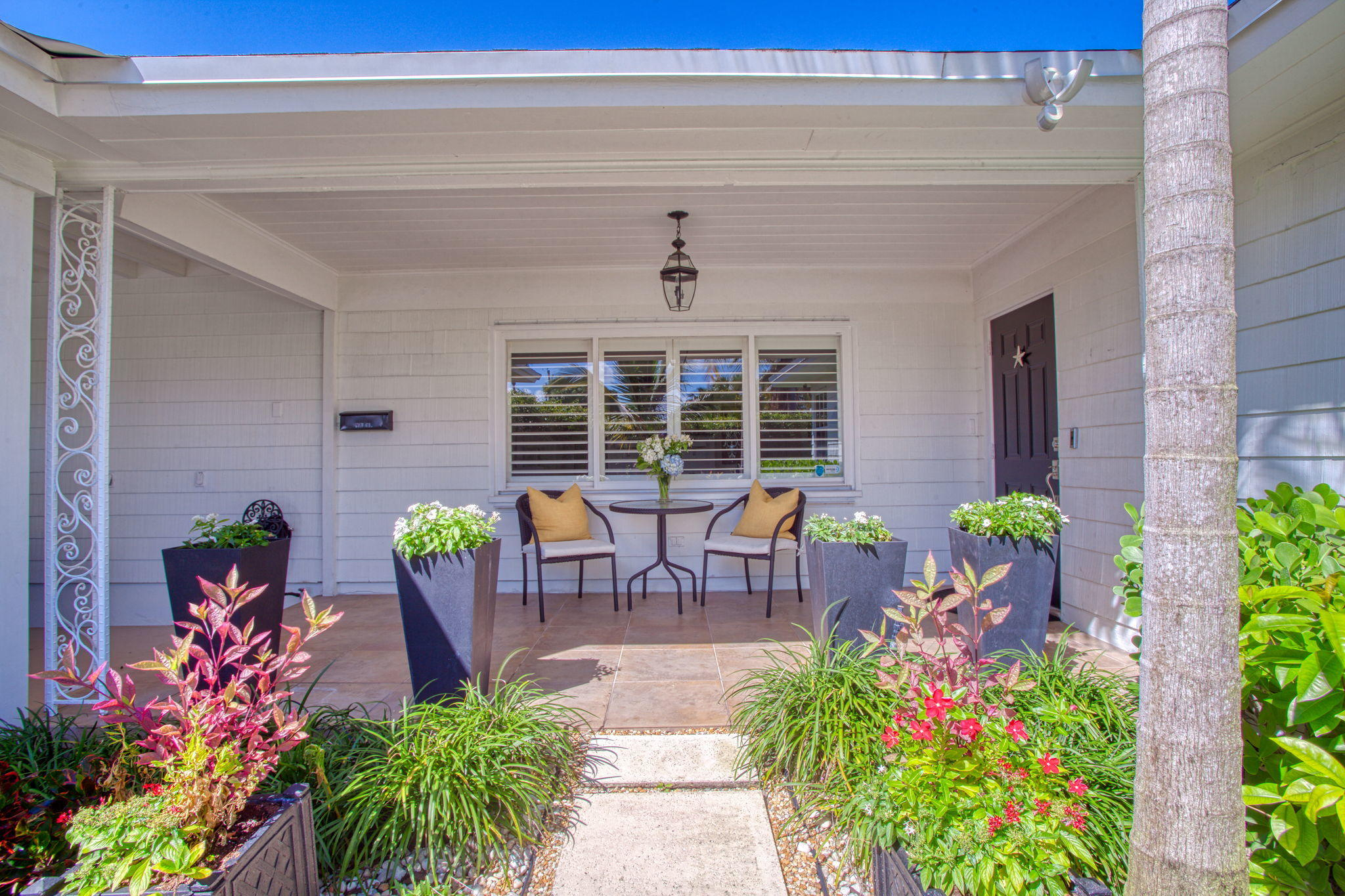 Welcome to this stunning 4-bedroom, 3-bathroom home in the charming SoSo district of West Palm Beach. Enjoy being close enough to downtown without the hustle and bustle, and only four miles away from Palm Beach Island. This home has been immaculately maintained. The master suite has a private entrance into the backyard where it overlooks a turquoise pool and lush landscaping. Lovely gardens and patios surround the back yard which has a bonus, a pool cabana for entertaining with an outside bar area with seating. Imagine the sun setting through the palms while you have dinner for two on one of your patios. Beautiful hard wood floors, a renovated bathroom in the 2nd master suite, this home has been outfitted with a water purification system throughout. The two-car carport will protect the vehicles from the Florida elements.   Book your private tour today.