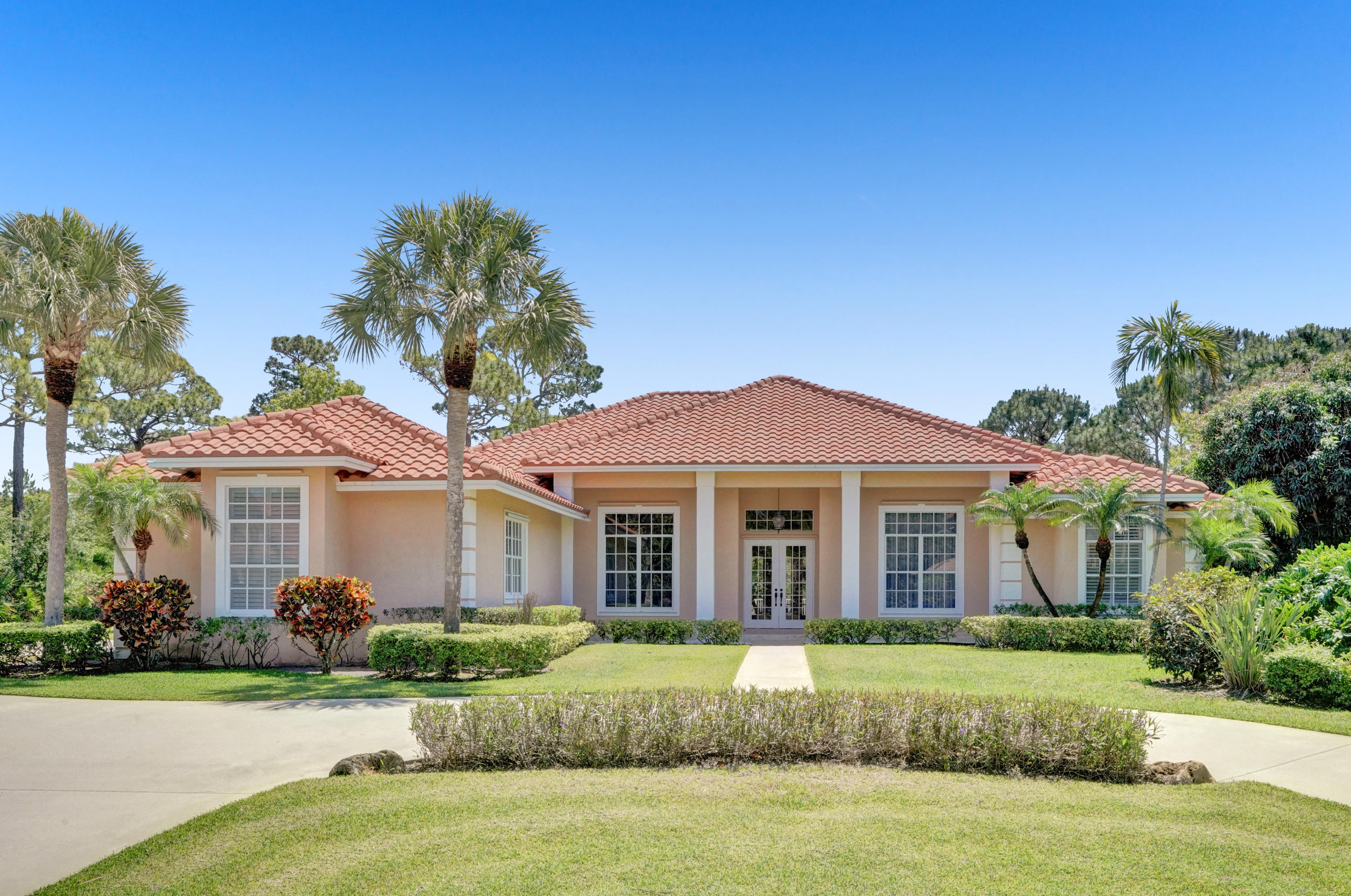 This 4bdr 3ba CBS home is nestled on 1.62 acres in the exclusive, sought after, Gated neighborhood of ISLAND COUNTRY ESTATES.  Your greeted with beautiful barrel-tile roof that was replaced in 2018, landscaping and circular driveway with oversized 2 car garage tucked away on East side.  As you enter, you'll notice the high ceilings, crown molding, and French doors that lead out to the private, Southern exposed pool with deep covered tongue and grove patio.  The kitchen/family room is equipped with S/S appliances 42'' cabinets, granite countertops, built-in shelves and eat-in kitchen/breakfast bar with butt-glass window overlooking the pool and covered area.  Large master suite has plantation shutters, French doors that lead out to the pool area, 2 walk-in closets, double sinks, separate shower, and tub and much more!