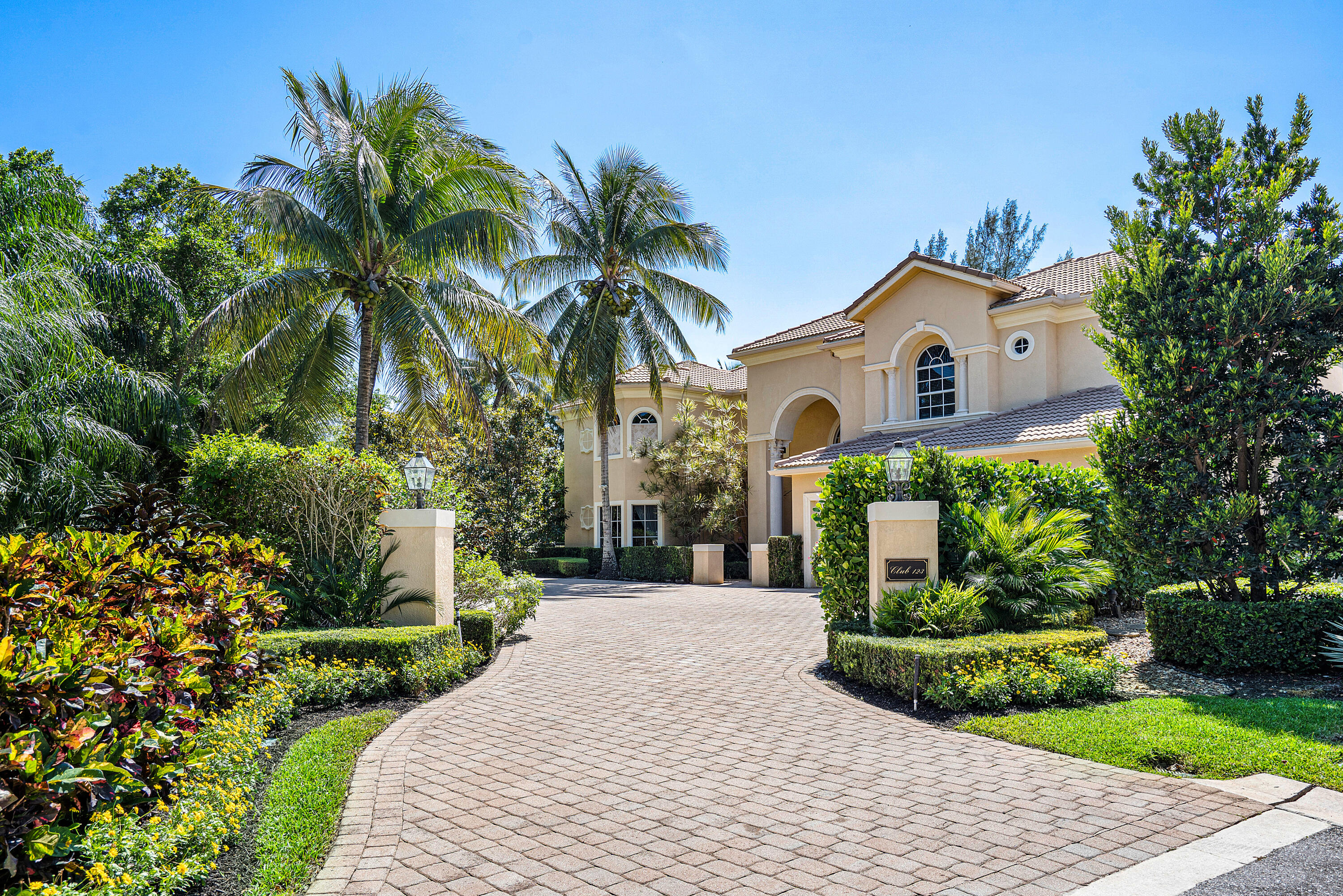Situated on a private enclave, this spectacular home is located in desirable Ballenisles on a premium lot. This stunning home boasts over 7,000 square feet of living space with 6bd/6.2ba, elevator, 2 primary suites, and 3 car garage. Walk in the light and bright entryway leading to the airy living room. The living room offers custom built-ins, fireplace, exquisite soaring ceilings, and beautiful views of the backyard oasis. The great room has plenty of natural light, custom built-ins, and backyard views. The gourmet kitchen is well appointed with granite countertops, Thermador double ovens, Thermador gas range, Sub-zero fridge, and marble flooring. This home also features 2 primary suites, one on each level. The ground level primary suite offers wood floors, fireplace, built-ins, his/hers closets, view of the lush garden, and oversized additional sitting room. The primary ensuite is well appointed with dual vanities, Jacuzzi tub, and glass shower. The upper level primary suite is completely private with its own staircase to the retreat. This suite boasts stunning views of the lush landscape, fireplace, and separate den/office room. The primary ensuite offers a Jacuzzi tub with fabulous views, dual vanities, granite countertops, glass shower, and marble flooring. The custom fitted dressing room is spectacular and a must see! The second staircase leads to a generous loft space and 3 guest bedrooms. Step outside to your own private retreat. The tranquil backyard boasts a sparkling custom pool and spa with sun shelf, fruit trees, and stunning golf course views. The covered patio with fireplace is perfect for entertaining with custom electric screens and outdoor kitchen. Lounge poolside surrounded by beautiful lush gardens or relax on the pool sun shelf. This property is beautifully landscaped and offers accented outdoor lighting. Other features include complete impact protection, elevator, electric screening and shades, whole house gas generator, side courtyard, and three laundry rooms. Call for your private tour!