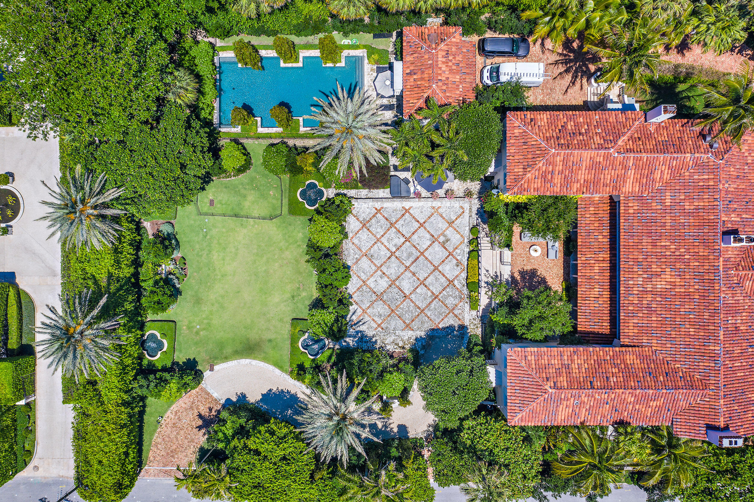 1928 Marion Sims Wyeth designed landmark home is located in the estate section on a 36,246 sf lot. The oversized landscape and gardens were designed by celebrity landscape architect Harry Nelson while the structure was stunningly renovated inside and out by Todd Michael Glaser. Only two houses from the ocean, this Mediterranean estate is comprised of 7 bedrooms, 9 baths and 2 half baths and totals 12,641 sf. The impressive great room boasts a ceiling height over 25' with beautifully stenciled Pecky Cypress adding to the allure of this authentic Wyeth estate. Interior features include 3 fireplaces, 2 beautifully enclosed galleries, an elevator, sauna, wine cellar, massage and fitness room, separate guest house, poolside cabana, full house generator, cooling tower and deeded beach access. DISCLAIMER: Information published or otherwise provided by the listing company and its representatives including but not limited to prices, measurements, square footages, lot sizes, calculations and statistics are deemed reliable but are not guaranteed and are subject to errors, omissions or changes without notice. All such information should be independently verified by any prospective purchaser or seller. Parties should perform their own due diligence to verify such information prior to a sale or listing. Listing company expressly disclaims any warranty or representation regarding such information. Prices published are either list price, sold price, and/or last asking price. The listing company participates in the Multiple Listing Service and IDX. The properties published as listed and sold are not necessarily exclusive to listing company and may be listed or have sold with other members of the Multiple Listing Service. Transactions where listing company represented both buyers and sellers are calculated as two sales. The listing company's marketplace is all of the following: Vero Beach, Town of Orchid, Indian River Shores, Town of Palm Beach, West Palm Beach, Manalapan Beach, Point Manalapan, Hypoluxo Island, Ocean Ridge, Gulf Stream, Delray Beach, Highland Beach, Boca Raton, East Deerfield Beach, Hillsboro Beach, Hillsboro Shores, East Pompano Beach, Lighthouse Point, Sea Ranch Lakes and Fort Lauderdale. Cooperating brokers are advised that in the event of a Buyer default, no commission will be paid to a cooperating Broker on the Deposits retained by the Seller. No commissions are paid to any cooperating broker until title passes or upon actual commencement of a lease. Some affiliations may not be applicable to certain geographic areas. If your property is currently listed with another broker, please disregard any solicitation for services. Copyright 2021 by the listing company. All Rights Reserved.